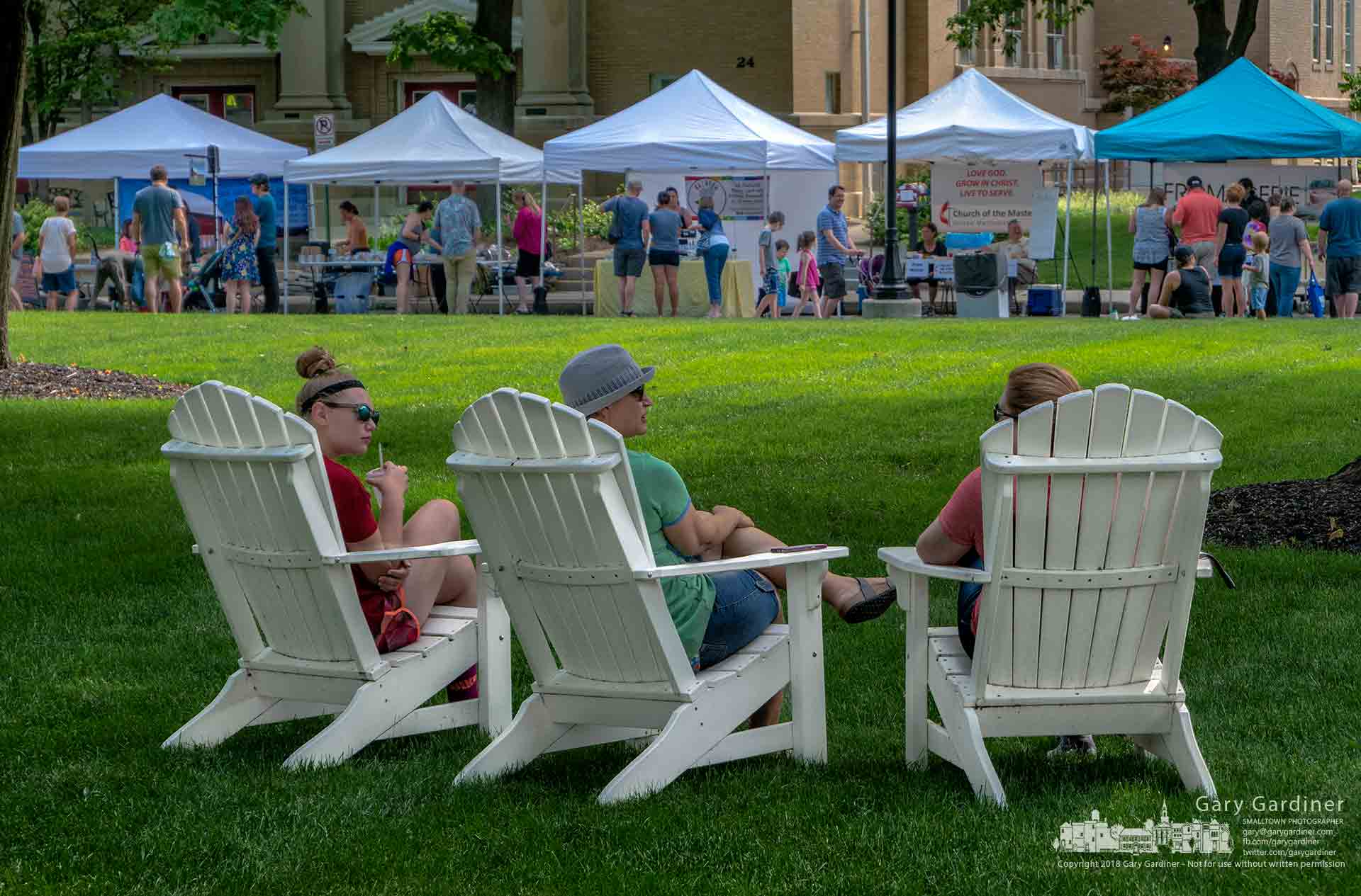 Shoppers at the Saturday Farmers Market settle into Adirondack chairs in front of Towers Hall after making selections from vendors at the market on Grove Street. My Final Photo for June 2, 2018.