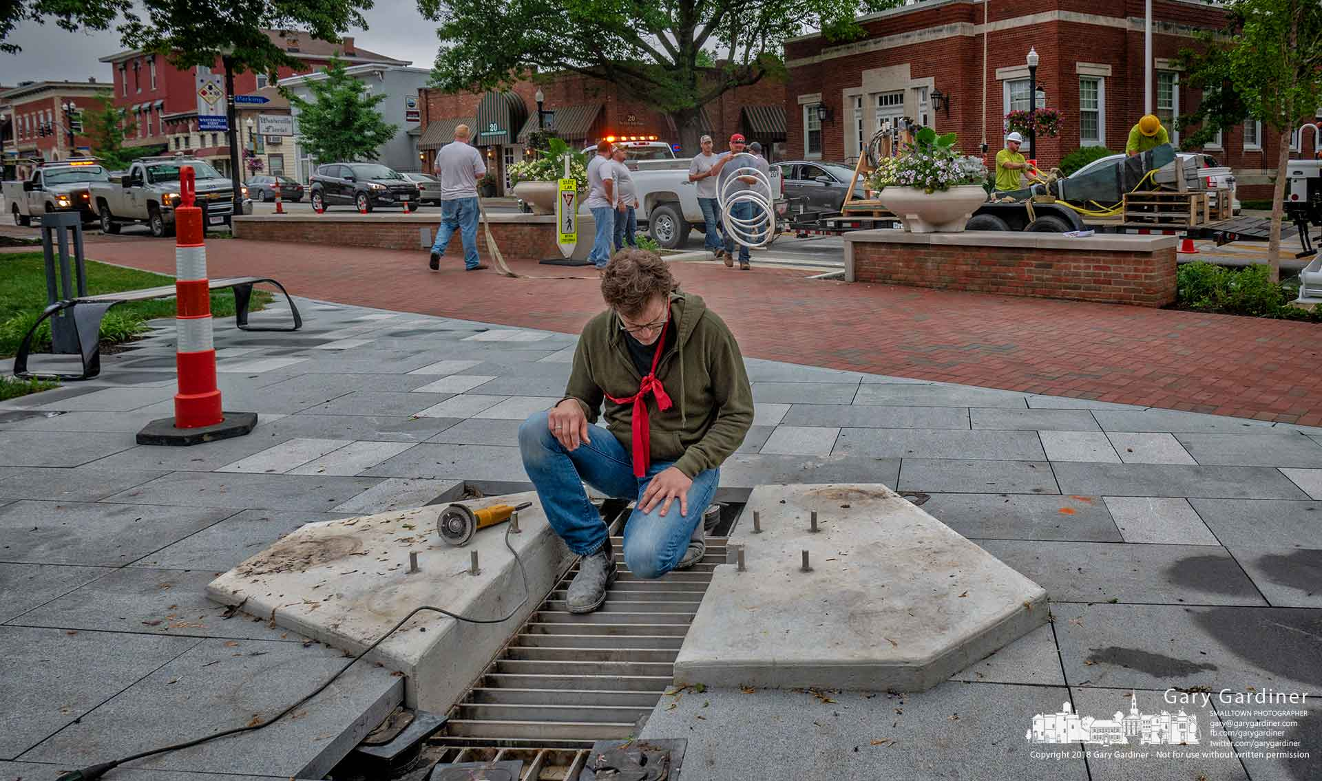 "Artist Mathew Gray Palmer inspects a section of the mount where his sculpture ""The American Issue"" will be installed in the courtyard in front of city hall. My Final Photo for June 13, 2018."