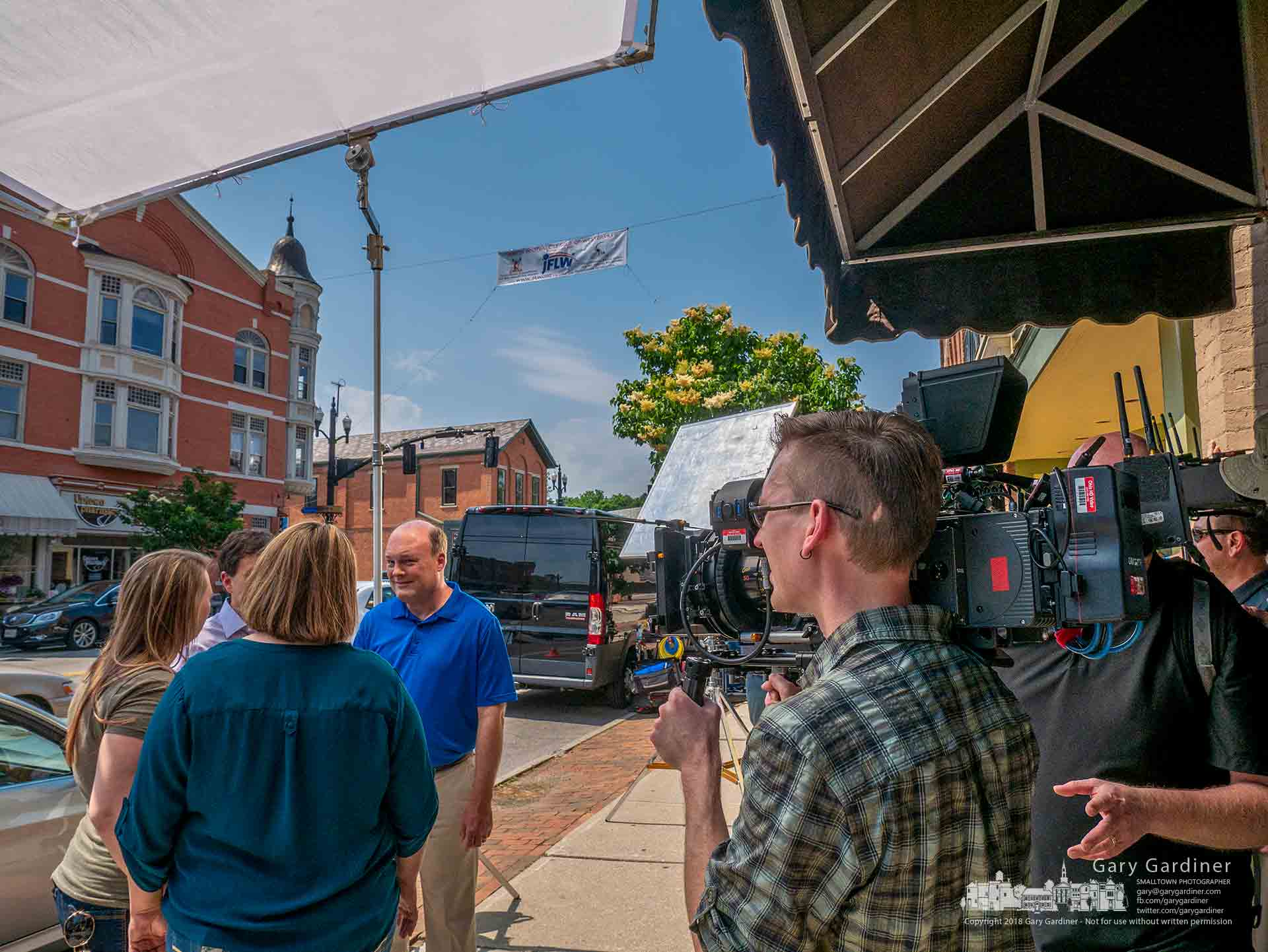 A video production crew records a portion of a congressional campaign ad in front of Pure Roots in Uptown Westerville. My Final Photo for June 7, 2018.