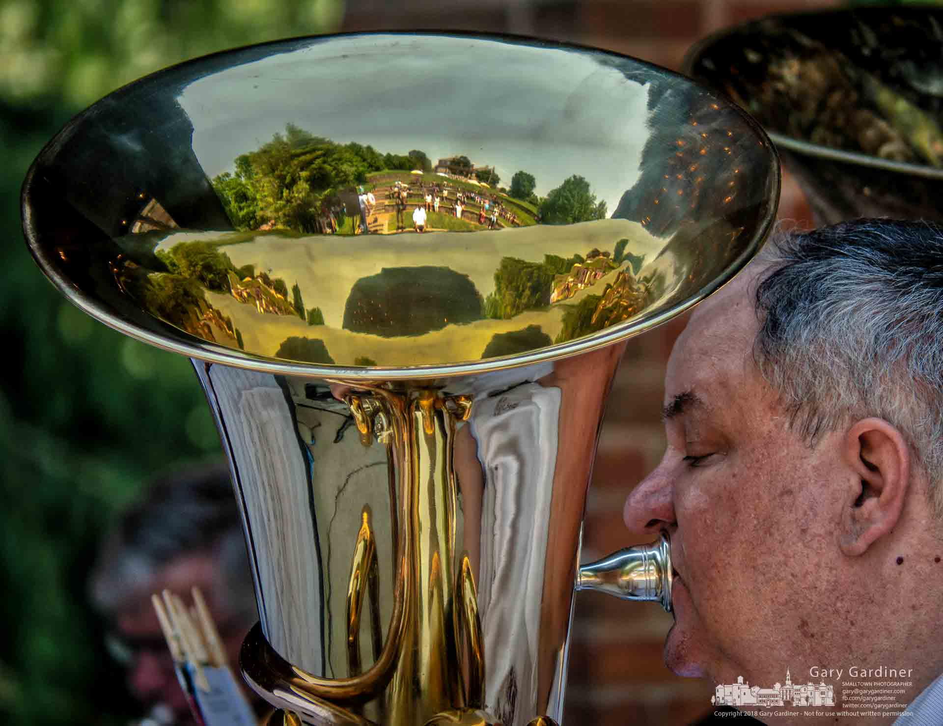 The Alum Creek Amphitheater is reflected in a musician's instrument as he performs during Westival at the park Saturday afternoon. My Final Photo for June 9, 2019.