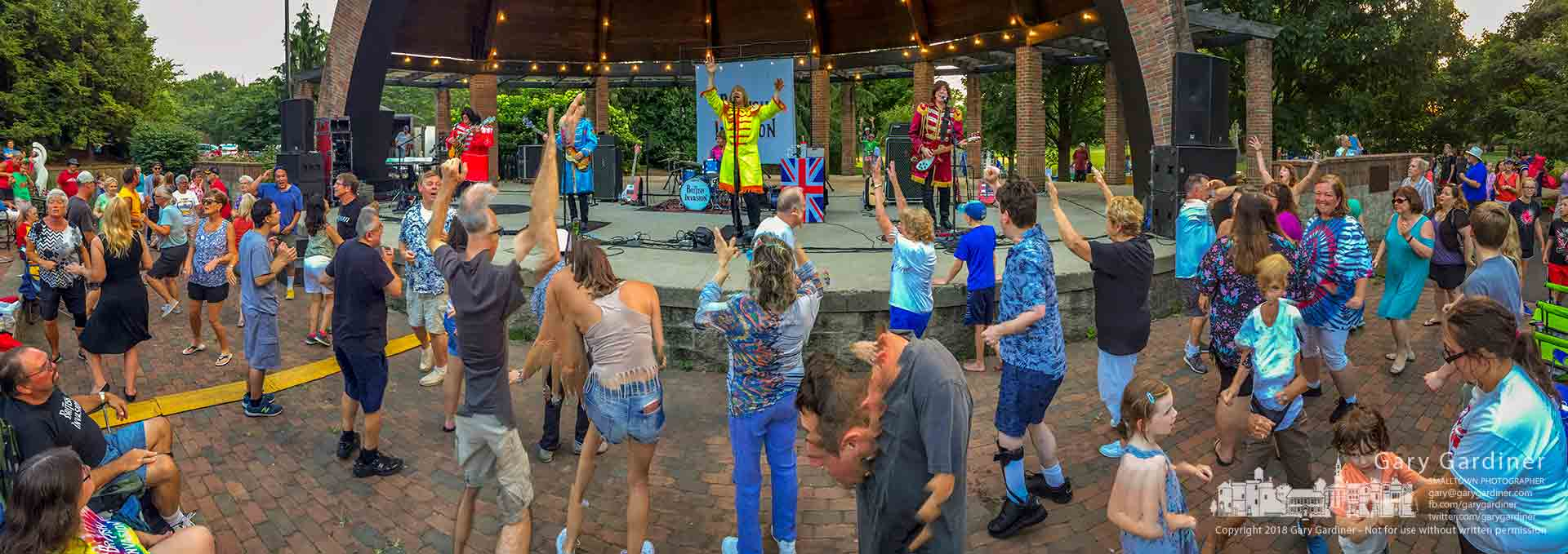 """Part of the overflow crowd twists and shouts to """"Twist and Shout,"""" the last song played by The British Invasion at their concert at the Alum Creek Amphitheater. My Final Photo for July 15, 2018."""