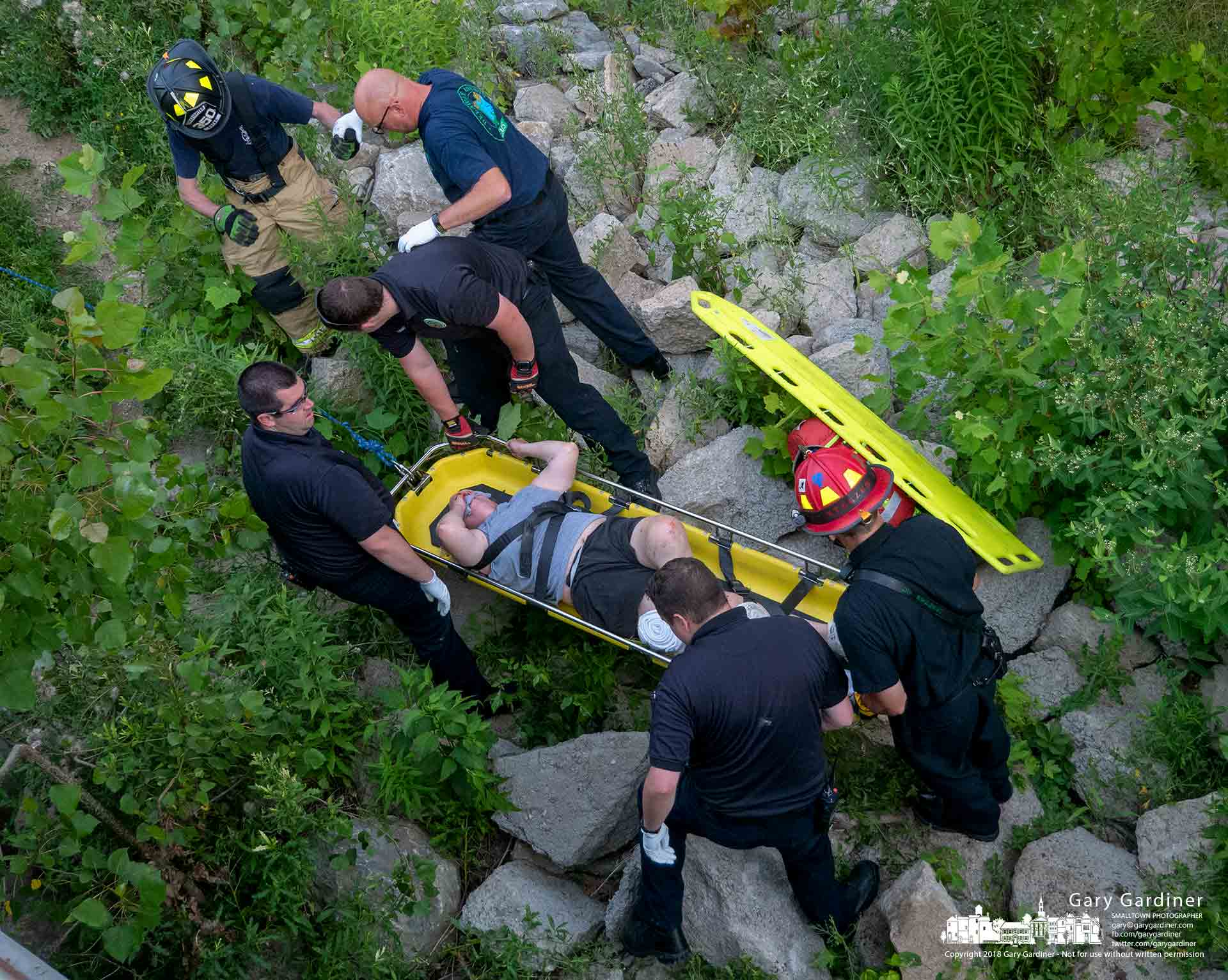 Delaware County first responders use a rescue gurney to carry a man from beneath the bridge over Big Walnut Creek in Galena. My Final Photo for July 7, 2018.