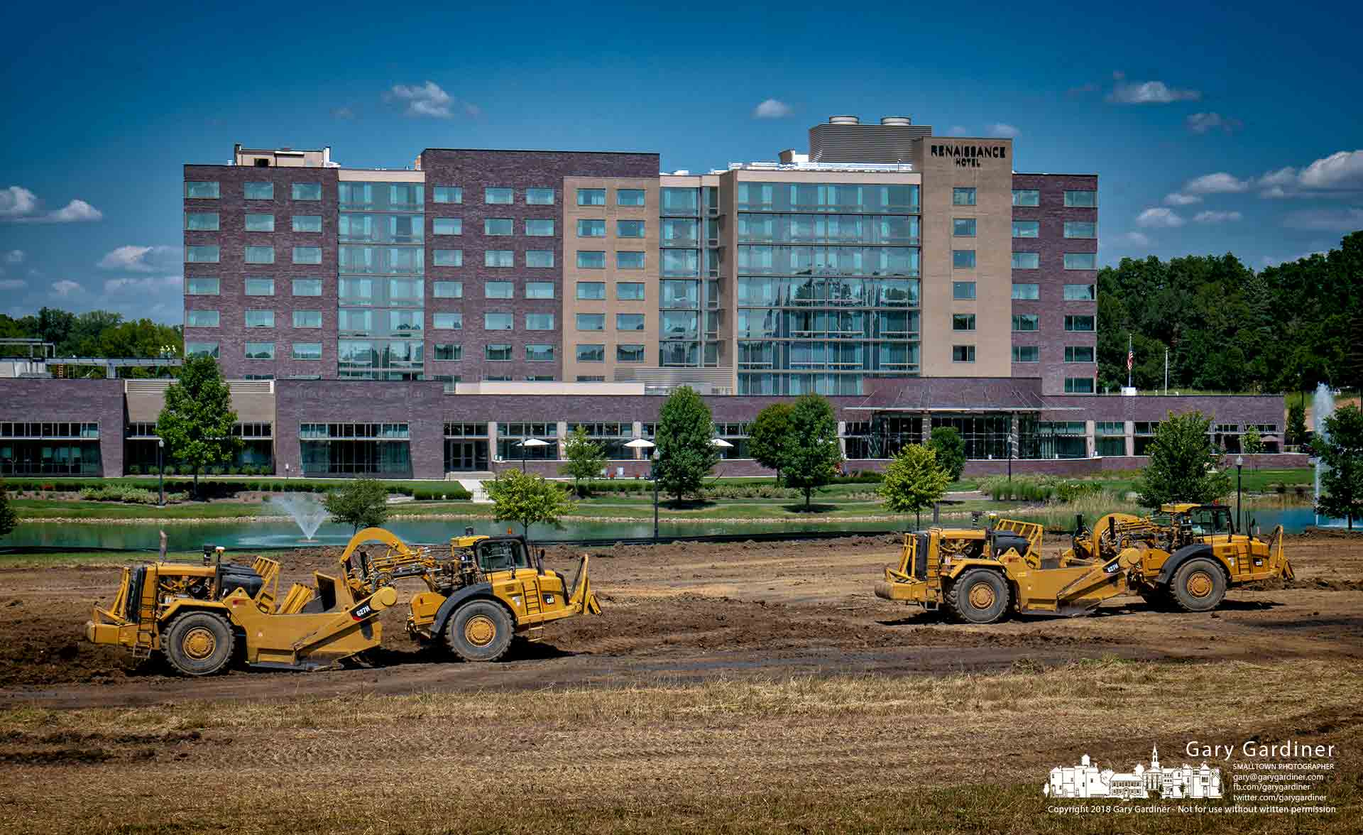 A pair of earthmovers transfer topsoil to a storage area and fill dirt onto the grounds where DHL is building its new North and South America headquarters in Westerville near the new Renaissance Hotel. My Final Photo for Aug. 23, 2018.