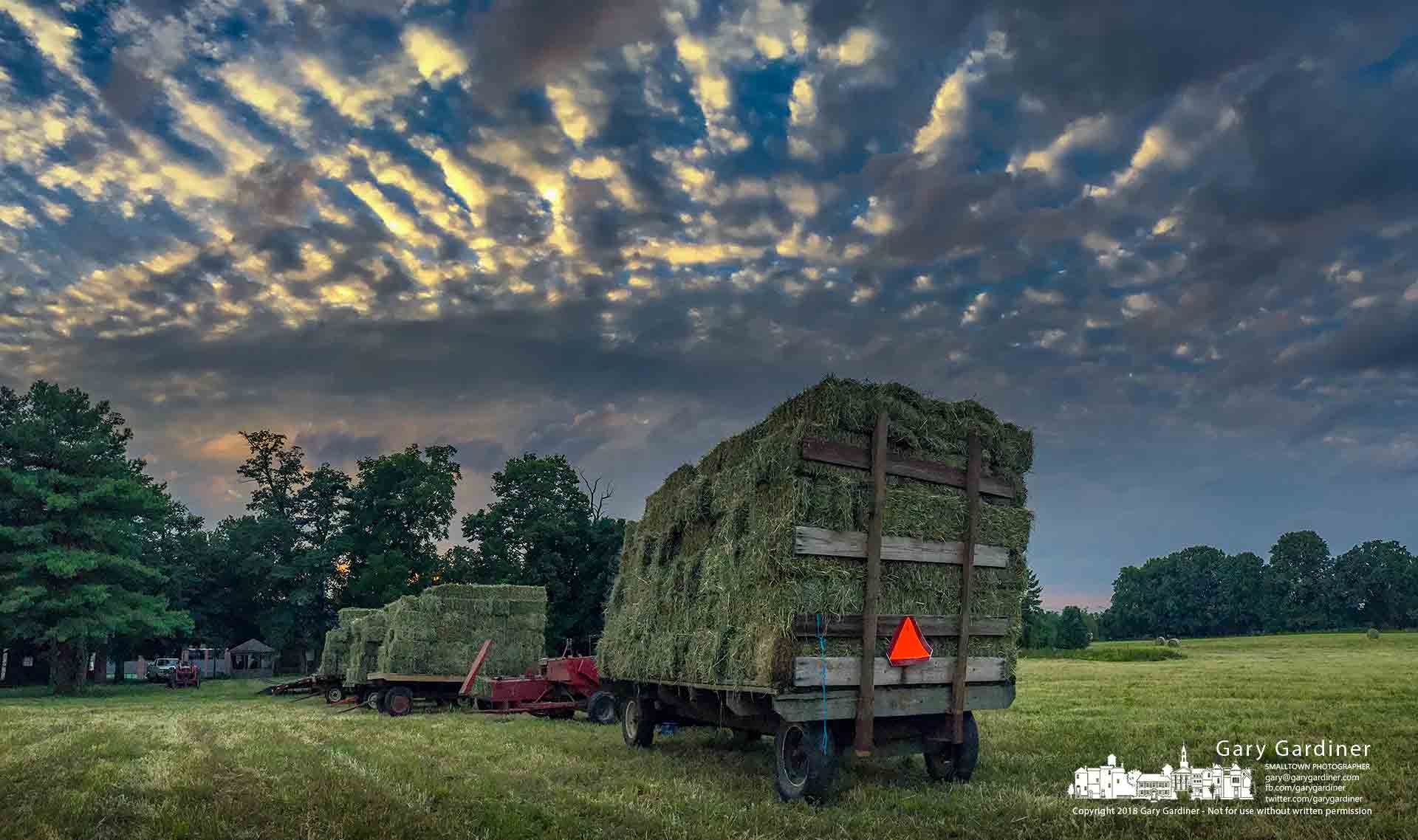 Trailers loaded with hay wait for transport to the barn after being harvested along Africa Road in Westerville before the arrival of Rain Saturday. My Final Photo for Aug. 24, 2018.