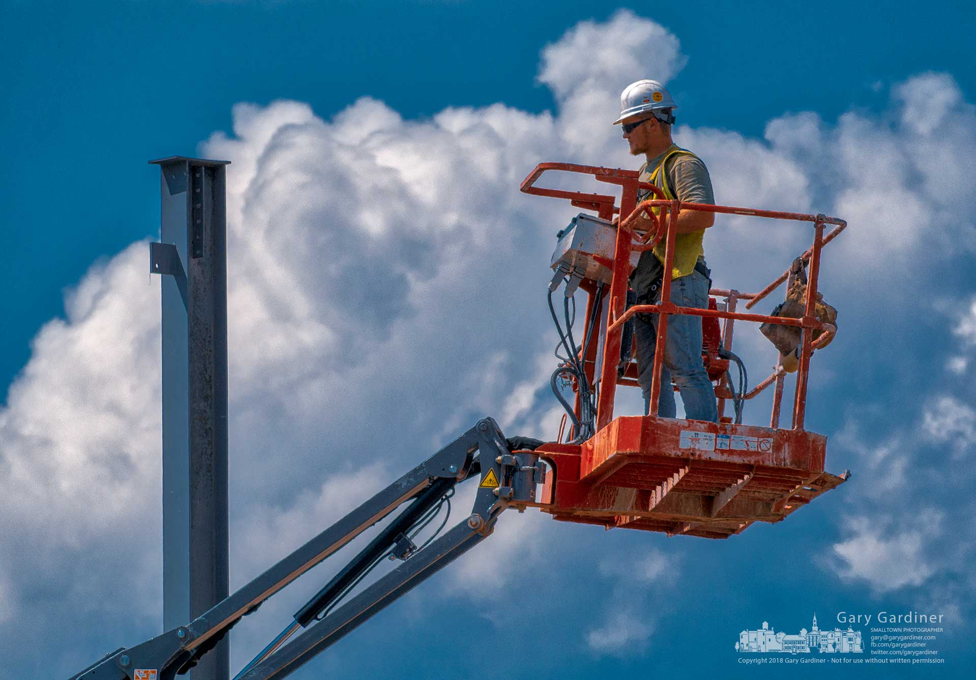 A steelworker inspects the top of a steel post installed for a medical office building on Altair Parkway. My Final Photo for Aug. 13, 2018.