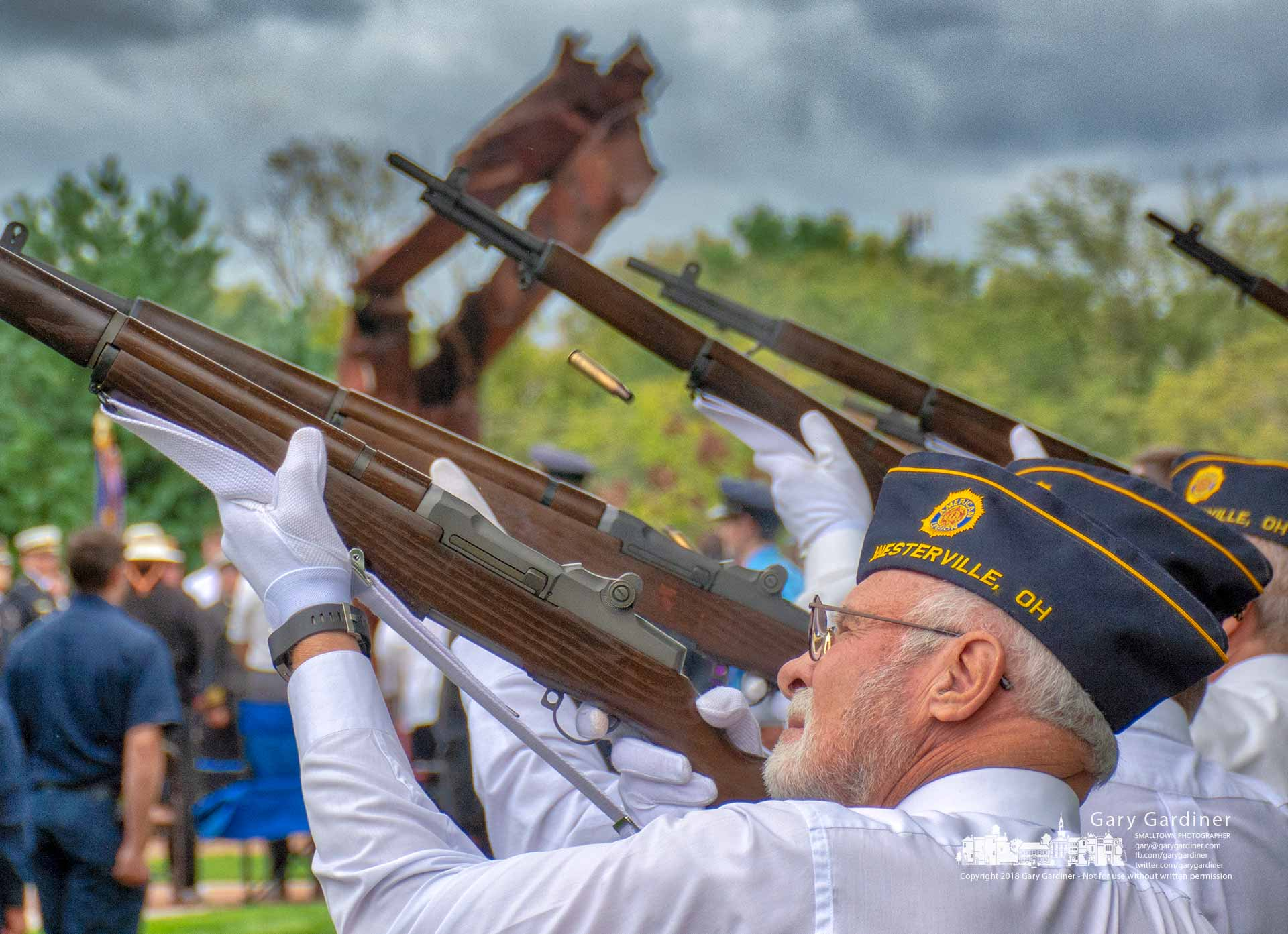 With the World Trade Center steel as a background, the American Legion Honor Guard offers a 21-gun salute at the conclusion of ceremonies marking the anniversary of the attacks on the towers in New York. My Final Photo for Sept. 11, 2018.
