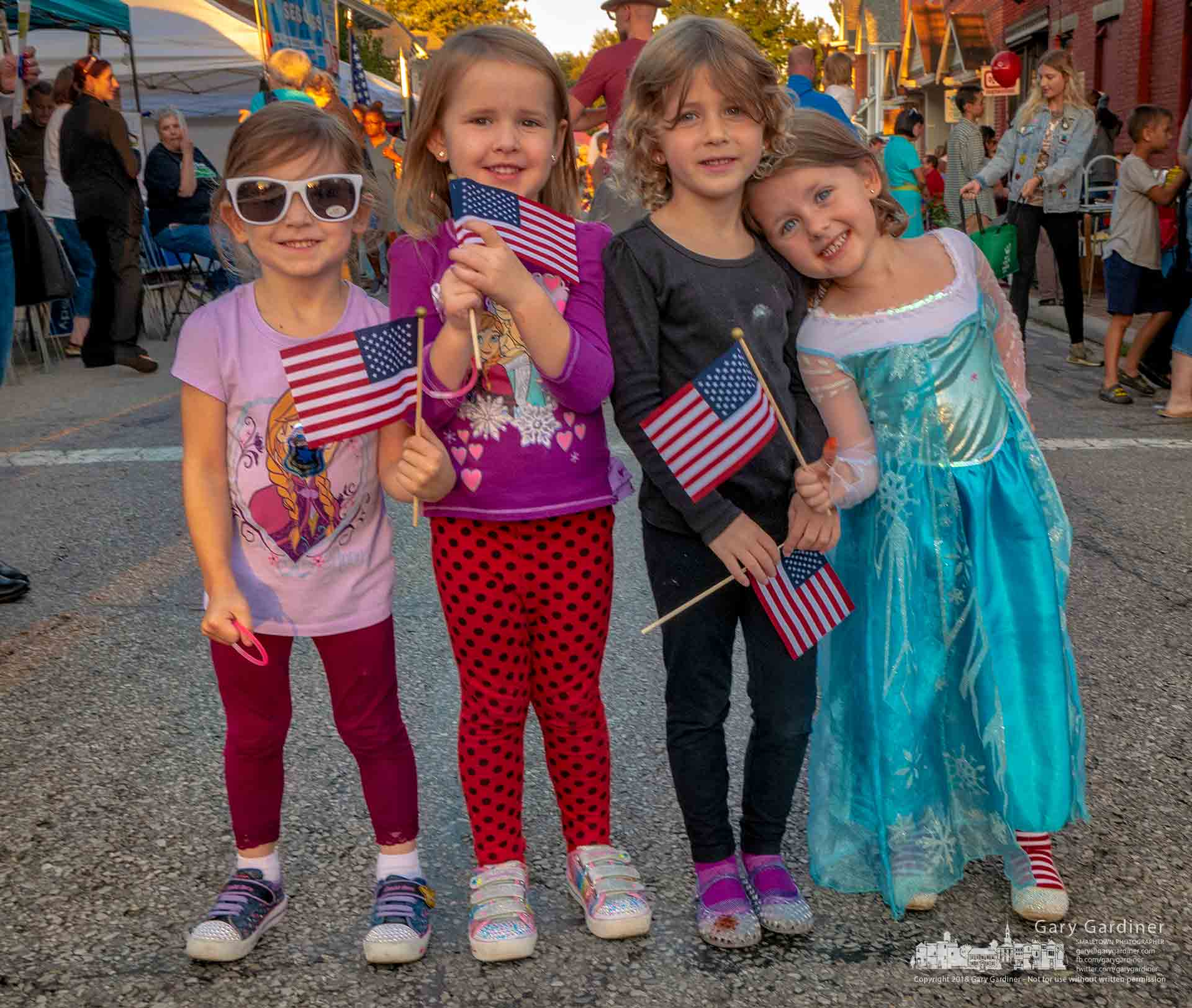 Four young girls pose with the flags given to them by members of the Westerville American Legion post durinf Fourth Friday in Uptown Westerville. My Final Photo for Sept. 28, 2018.