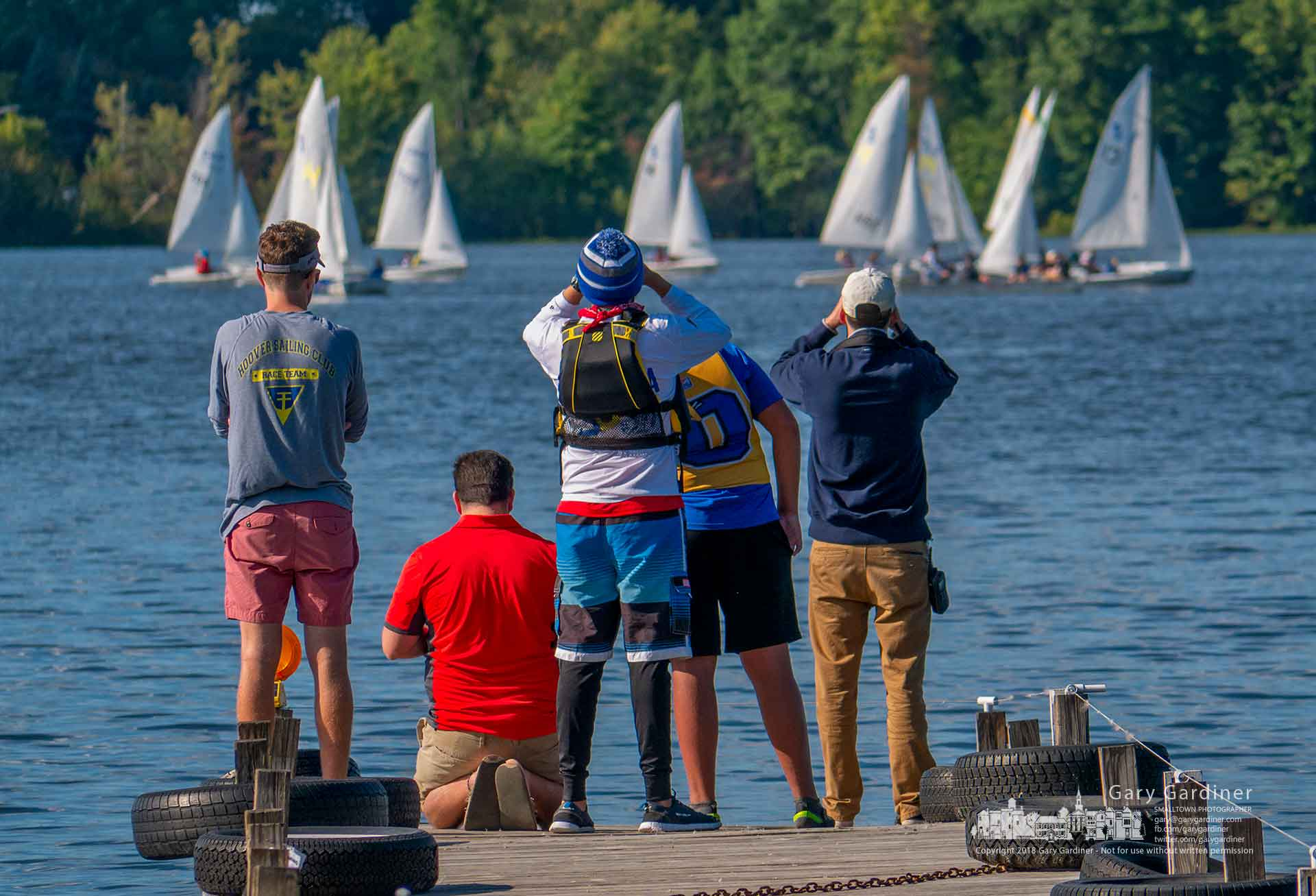Family and friends stand at the end of one of the docks at Hoover Sailing Club to check the progress of sailors in the MISSA Great Oaks Qualifier on Hoover Reservoir. My Final Photo for Sept. 29, 2018.