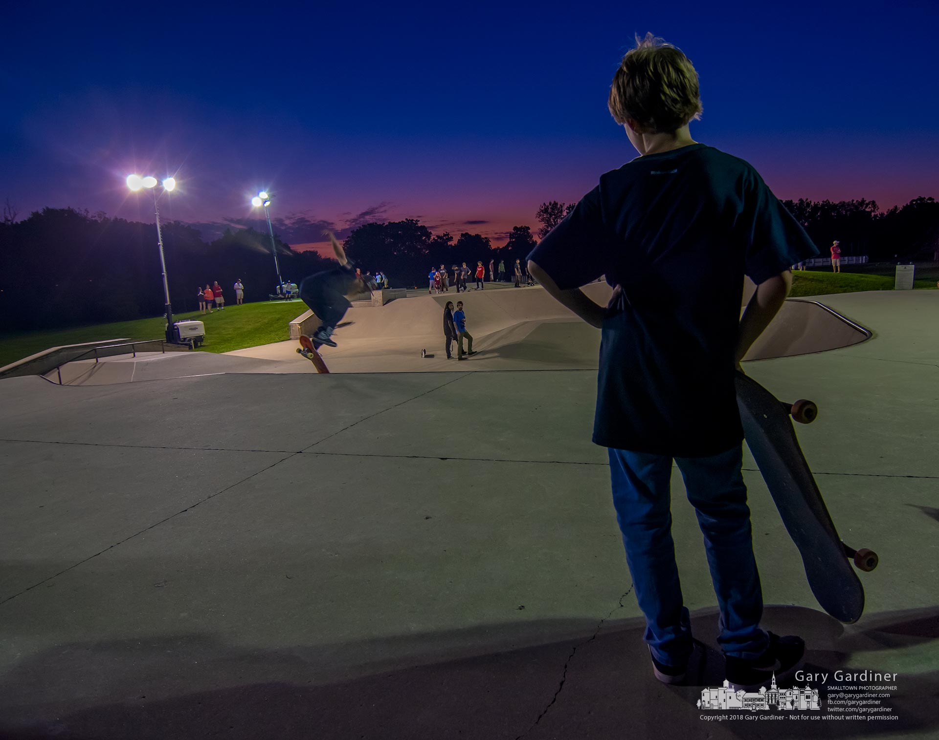 A young skater waits his turn at the start of Skate Night at the Westerville Skatepark, the once-a-year event where the skate bowl is lit at night for skaters. My Final Photo for Sept. 14, 2018.