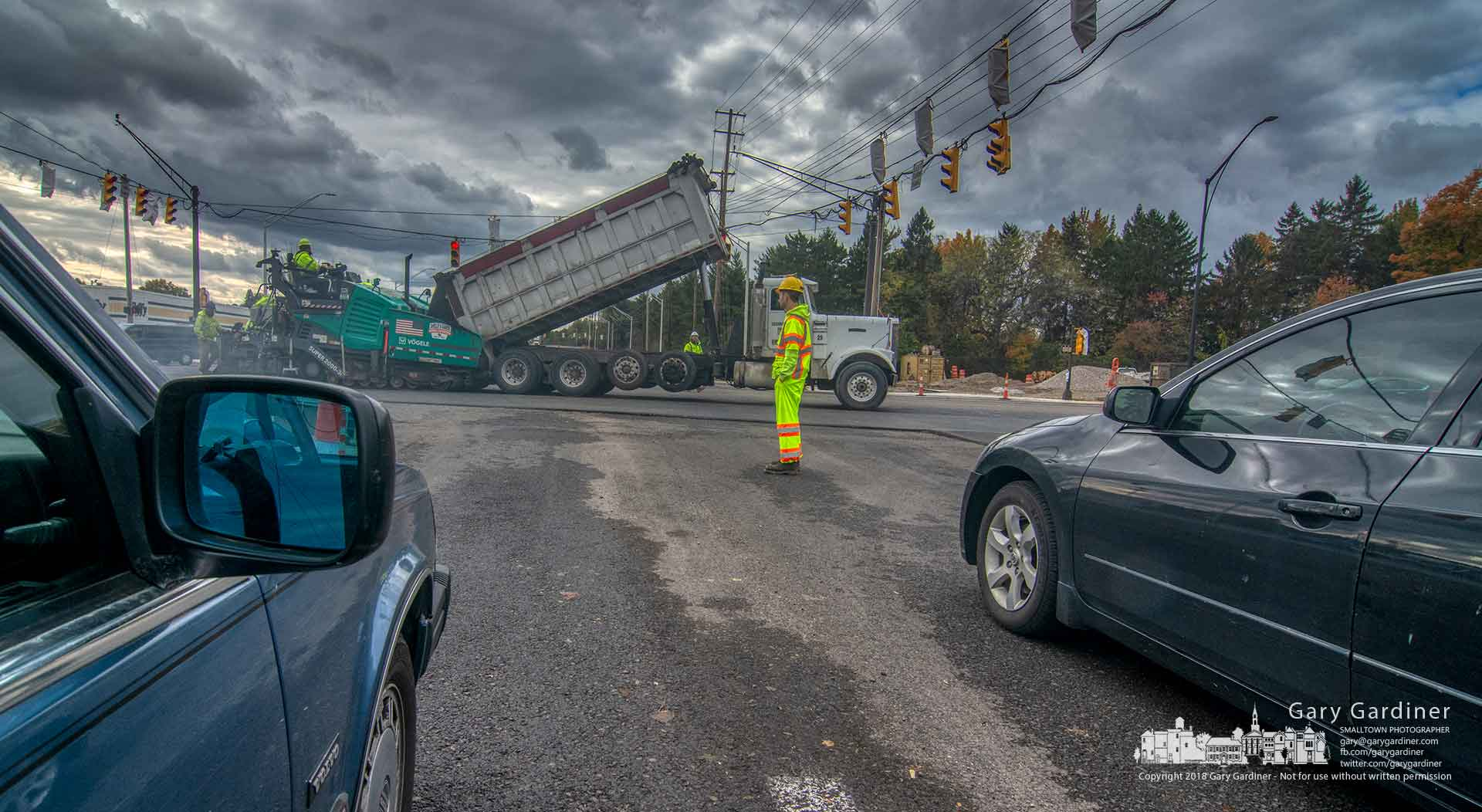 Traffic sits stopped as a road drew lays asphalt in the intersection of Schrock Road and Cleveland Avenue after a delay during the weekend because of the weather. My Final Photo for Oct. 29, 2019.