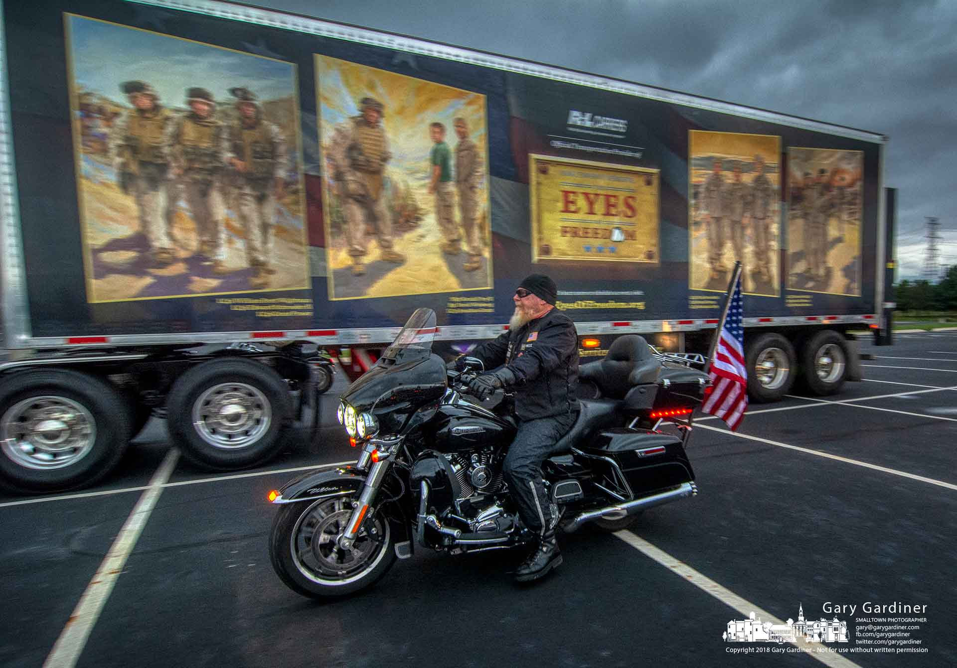 A motorcyclist rides past the Eyes of Freedom trailer as he and about 100 other riders gather for a motorcade to take the Lima Company Memorial for display at the Circleville Pumpkin Show. My Final Photo for Oct. 15, 2018.