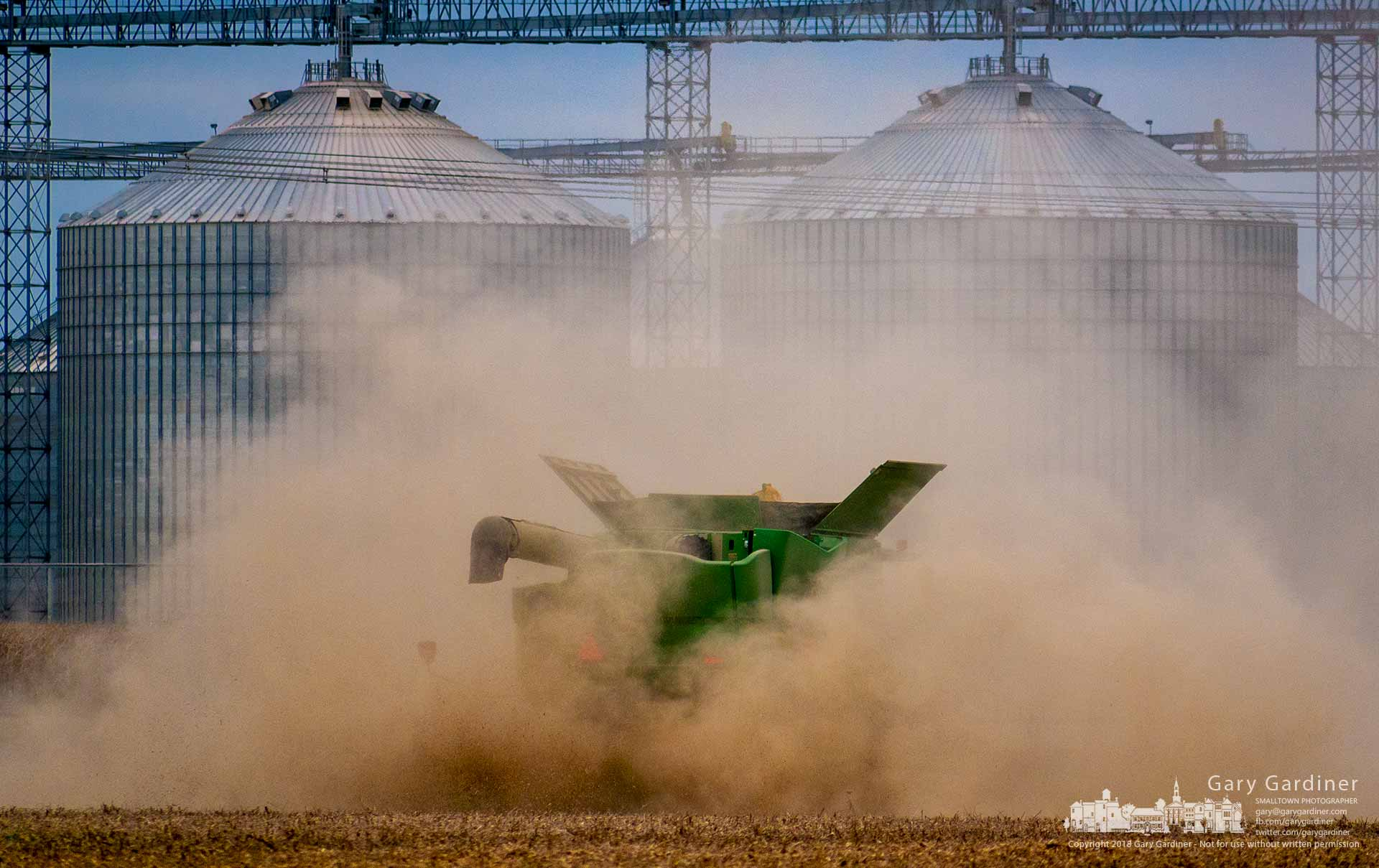 A combine throws up a cloud of soybean dust as it runs through a field at the grain elevator near Croton, Ohio. My Final Photo for Oct. 19, 2018.