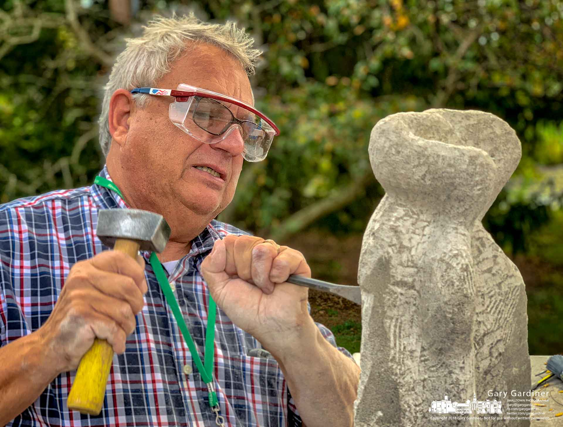 With hammer and chisel in hand a member of the Westerville Senior Center sculpting classes chips away at his creation at a table outdoors at the center on West Main Street. My Final Photo for Oct. 4, 2018.