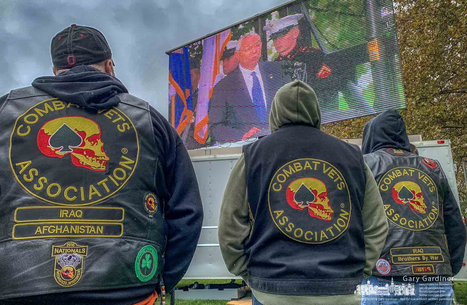 Three veterans stand on a cold in rain and wind to listen as Ret. U.S. Army General Colin Powell speaks at the dedication of the National Veterans Memorial and Museum in Columbus Saturday. My Final Photo for Oct. 27, 2018.