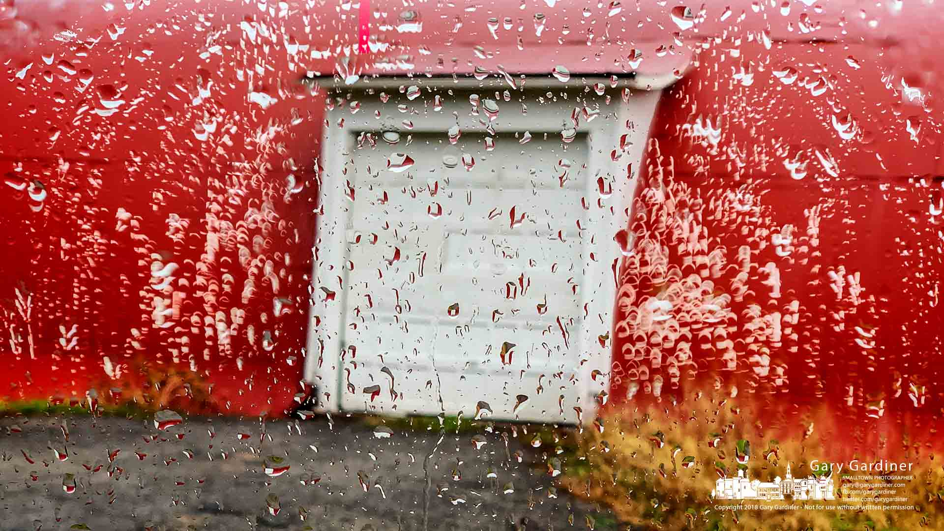 Raindrops roll down a car window parked on a rainy day at the Braun Farm barn in Westerville. My Final Photo for Nov. 19, 2018.