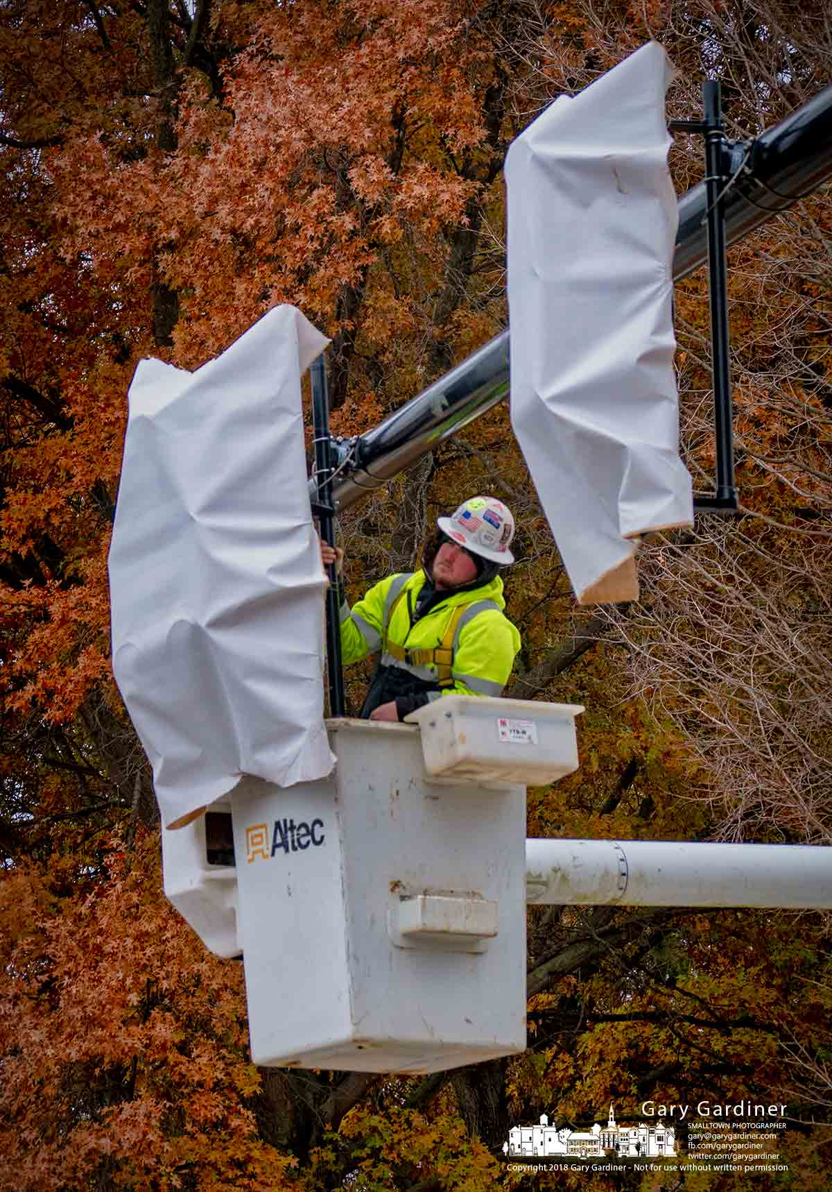 An electrician installs one of the new traffic signals over the entrance to Sharon Woods Park on Cleveland Ave. where construction on the intersection of Cleveland and Schrock Road nears an end. My Final Photo for Nov. 20, 2018.