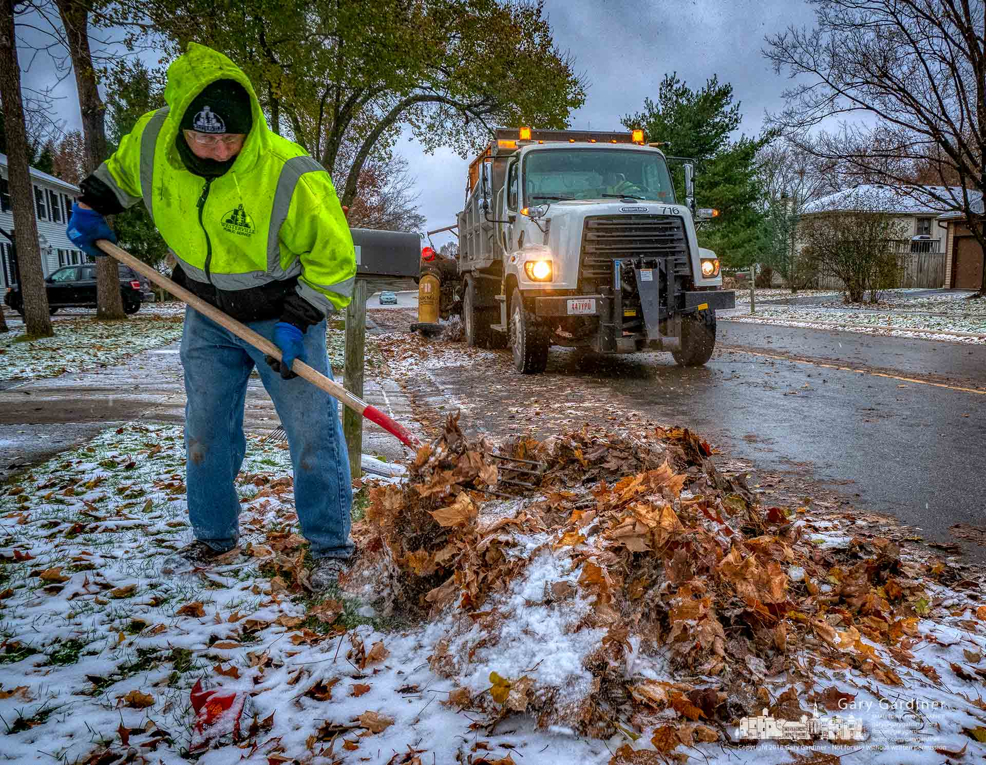 City workers used pitchforks instead of lawn rakes to clear wet, frozen leaves for retrieval during the city's leaf collection program. My Final Photo for Nov. 27, 2018.