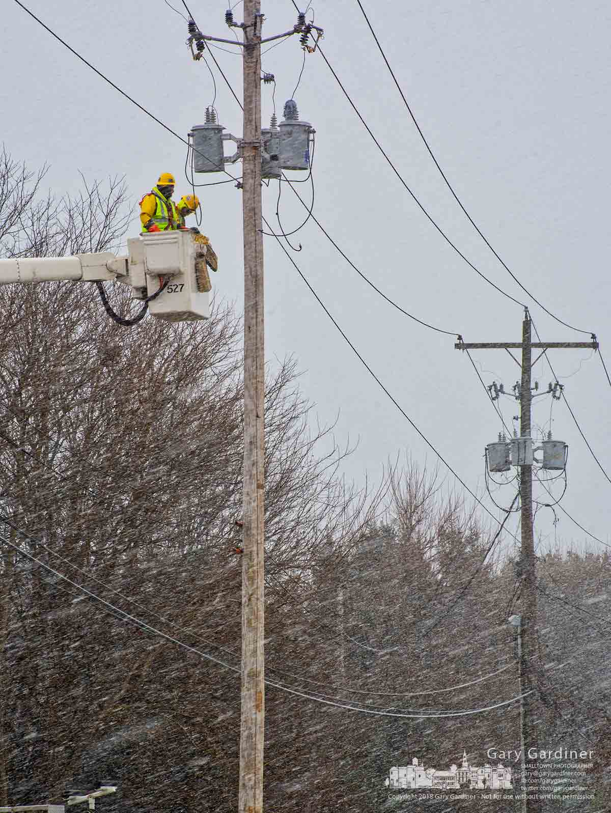 City electric workers work through a heavy snow squall to prepare a new set of transformers for power along Huber Village near State Street. My Final Photo for Nov. 29, 2018.