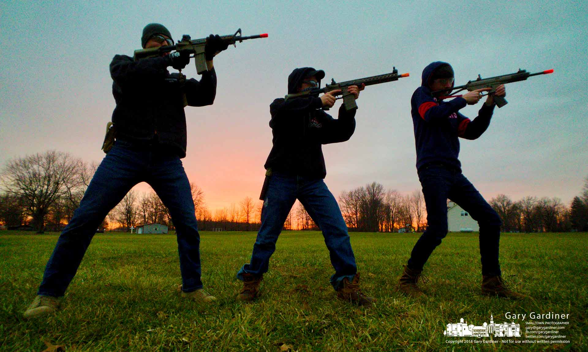 The three grandsons pose with their Airsoft rifles as the Christmas day sun sets after the trio consumed a large portion of food and elected to burn it off in the backyard. My Final Photo for Dec. 25, 2018.