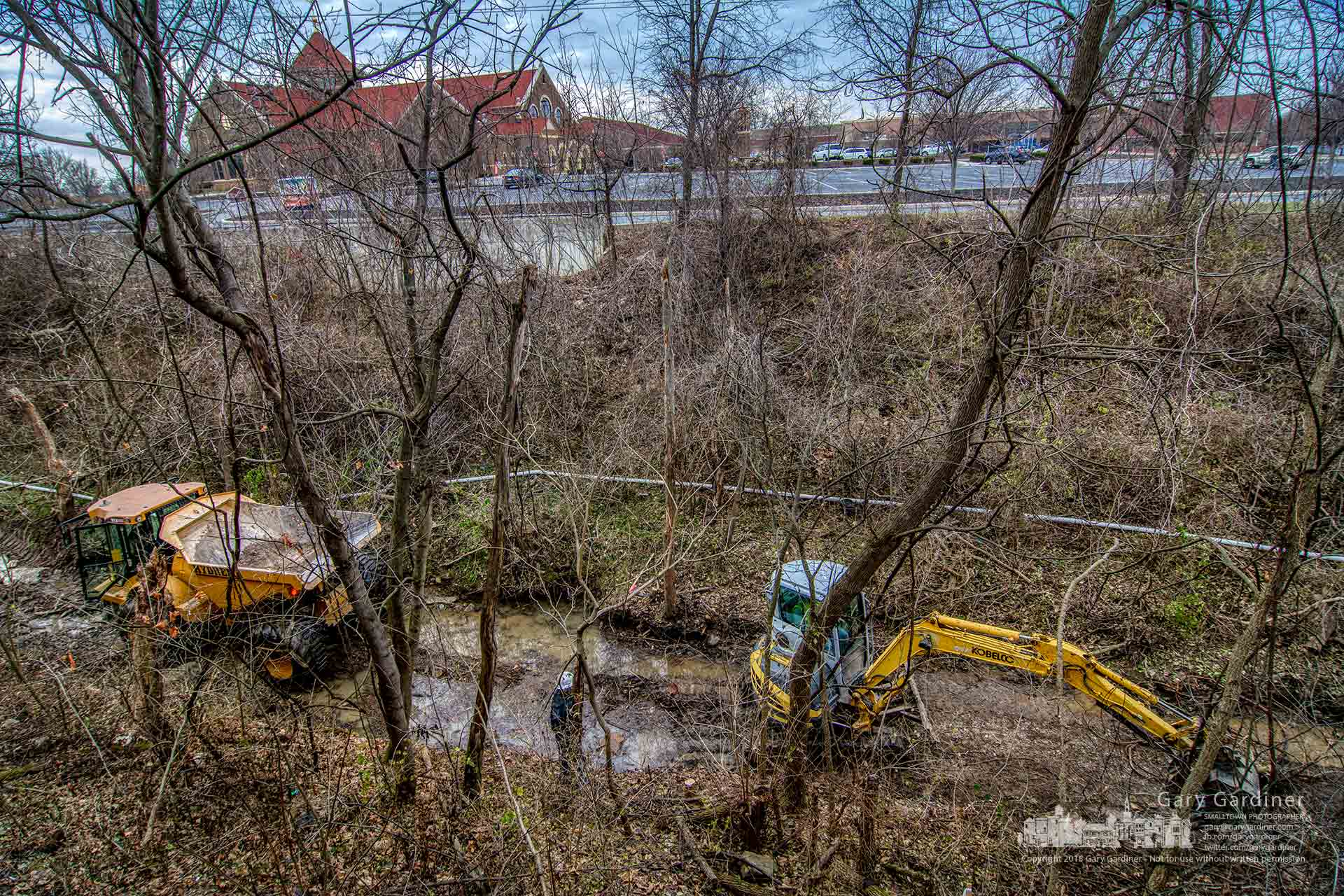 Contractors clear Alkire Run of debris preparing it for the addition heavy stones as part of the creekbed reinforcement and remediation. My Final Photo for Dec. 12, 2018.