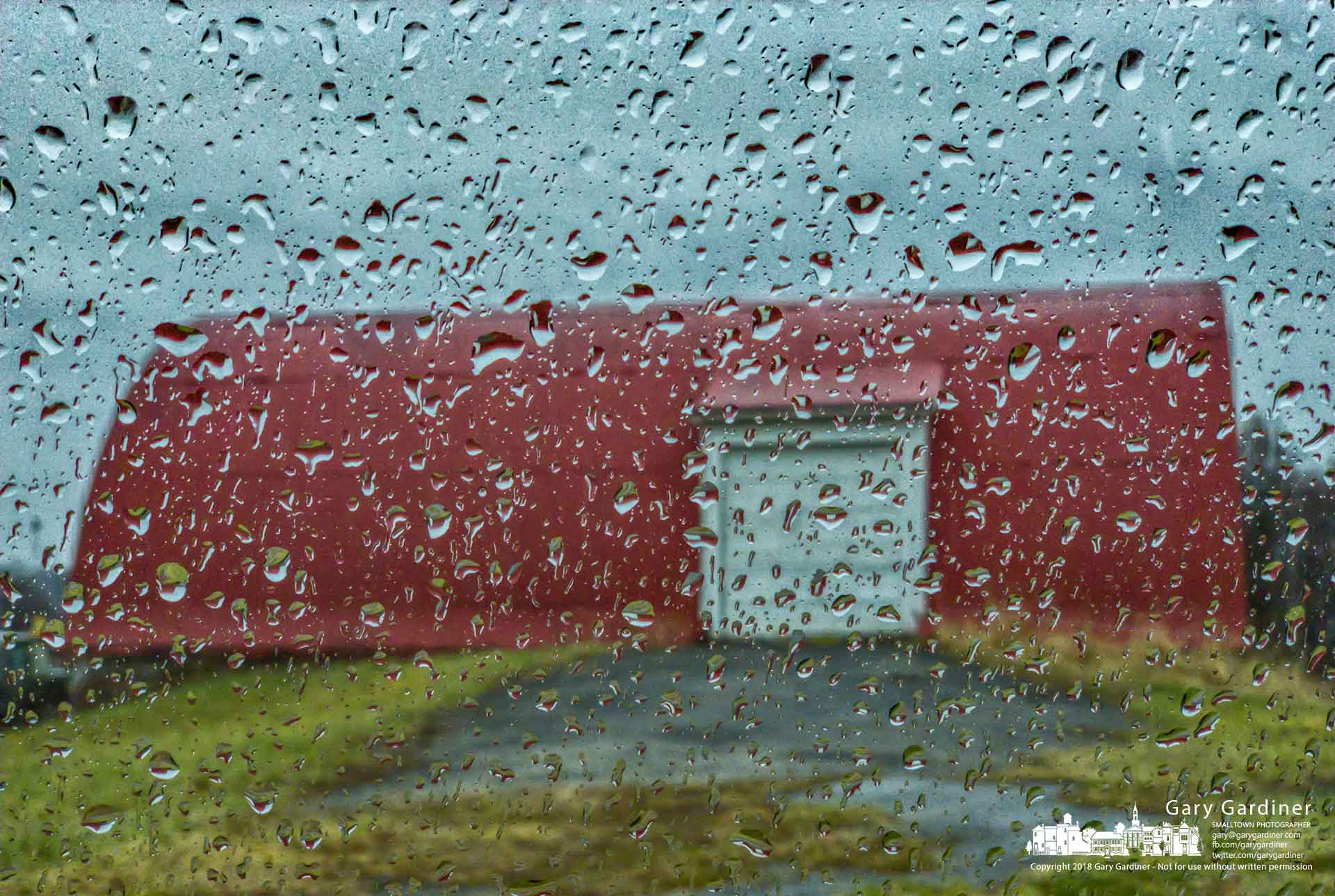 A morning rain covers the windows of a car parked at the Braun Farm barn with little hope for anything other than continued storms for the day. My Final Photo for Dec. 31, 2018.