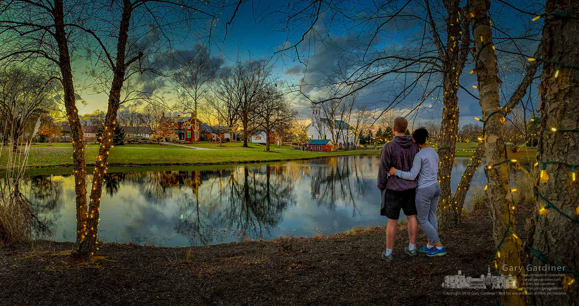 A couple pauses on their evening walk to look at the sunset and the holiday lights decorating Everal Barn and Heritage Park in Westerville. My Final Photo for Dec. 2, 2018.