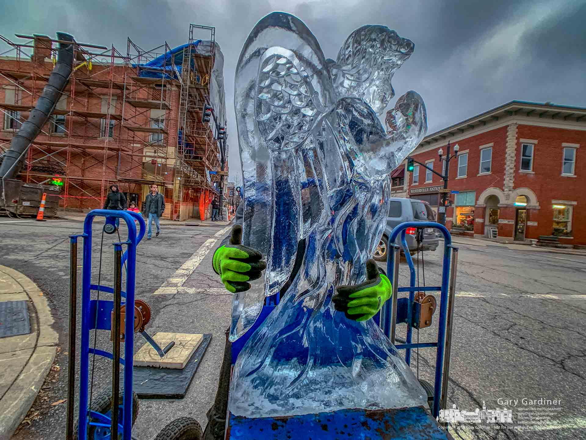 An angel ice sculpture is transferred to a dolly on its way to a display of frozen statues in Uptown Westerville the weekend before Christmas. My Final Photo for Dec. 21, 2018.