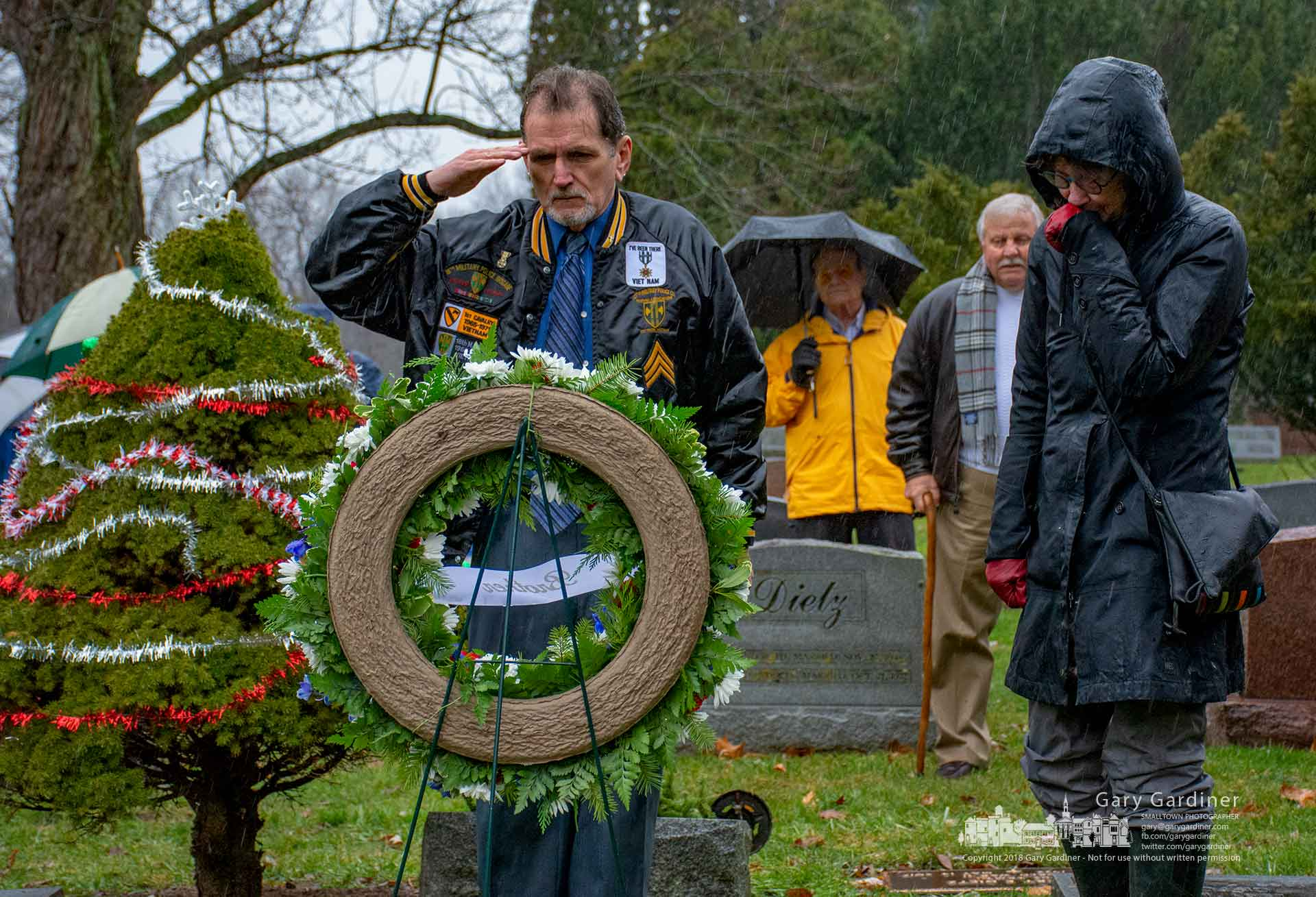 Family and friends gather at the grave of Dingus Banks as it received the first wreath placement during Wreaths Across America t Otterbein Cemetery Saturday. My Final Photo for Dec. 15, 2018.