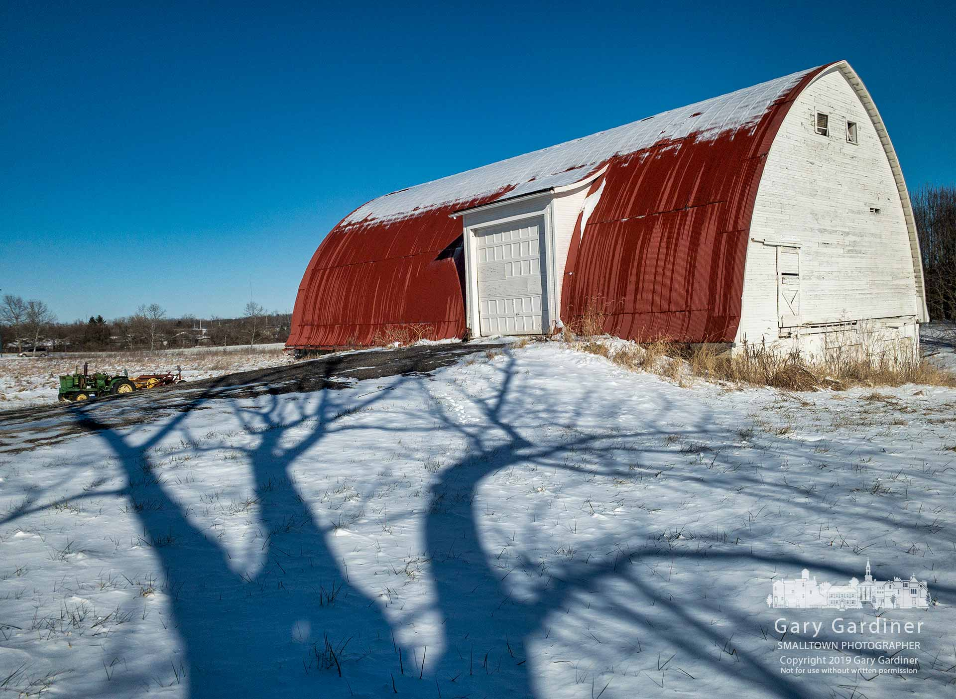 The shadow of the walnut tree behind the old farmhouse at the Braun Farm slowly creeps toward the barn on a crisp, cold winter afternoon. My Final Photo for Jan. 21, 2019