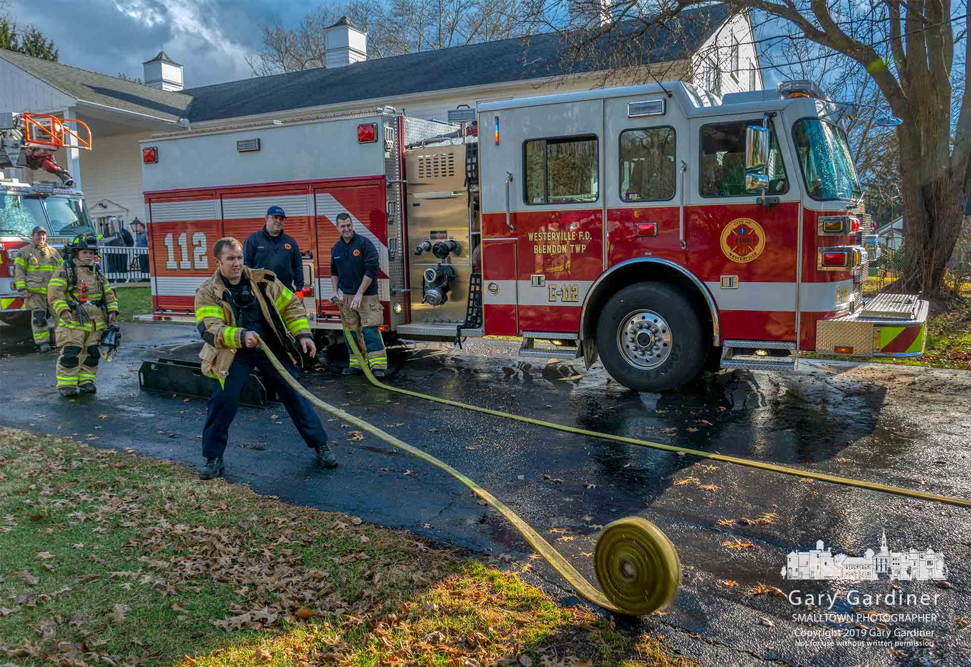 Firefighters roll out hoses preparing them for storage after completing a training program at the old party house on the future park property on Hempstead Road. My Final Photo for Jan. 8, 2019.
