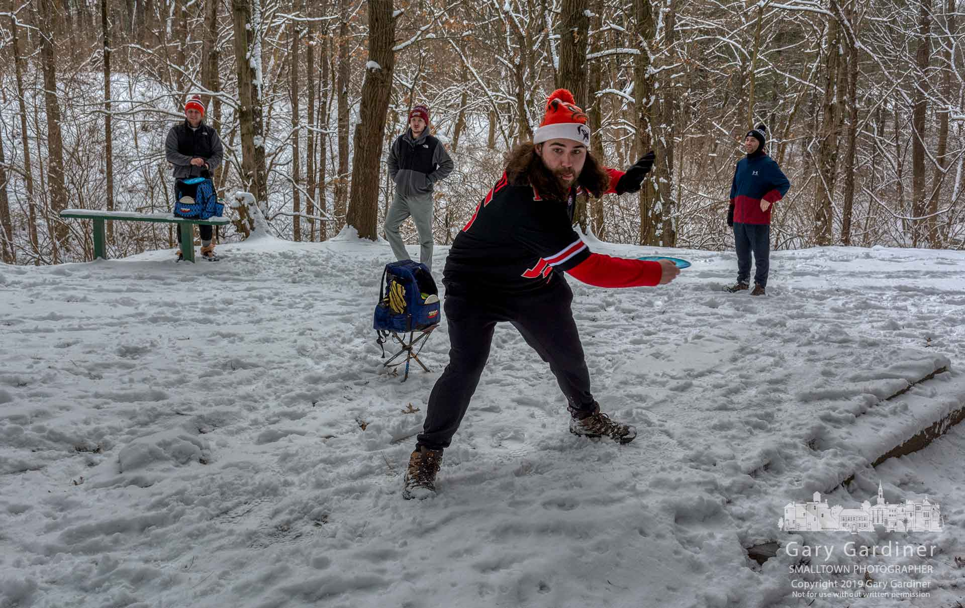 A quartet of disc golfers plays the snow-covered back nine at the course at Hoover Reservoir. My Final Photo for Jan. 13, 2019.
