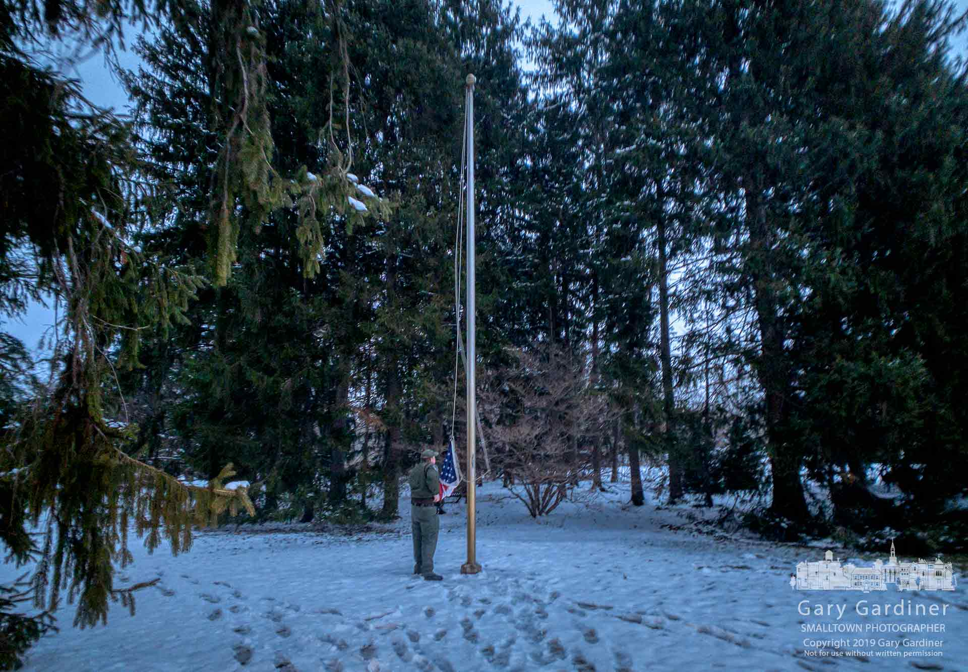 A ranger at Inniswood Metro Gardens lowers the flag at dusk and near the time of the park closing for the day. My Final Photo for Jan. 16, 2019.