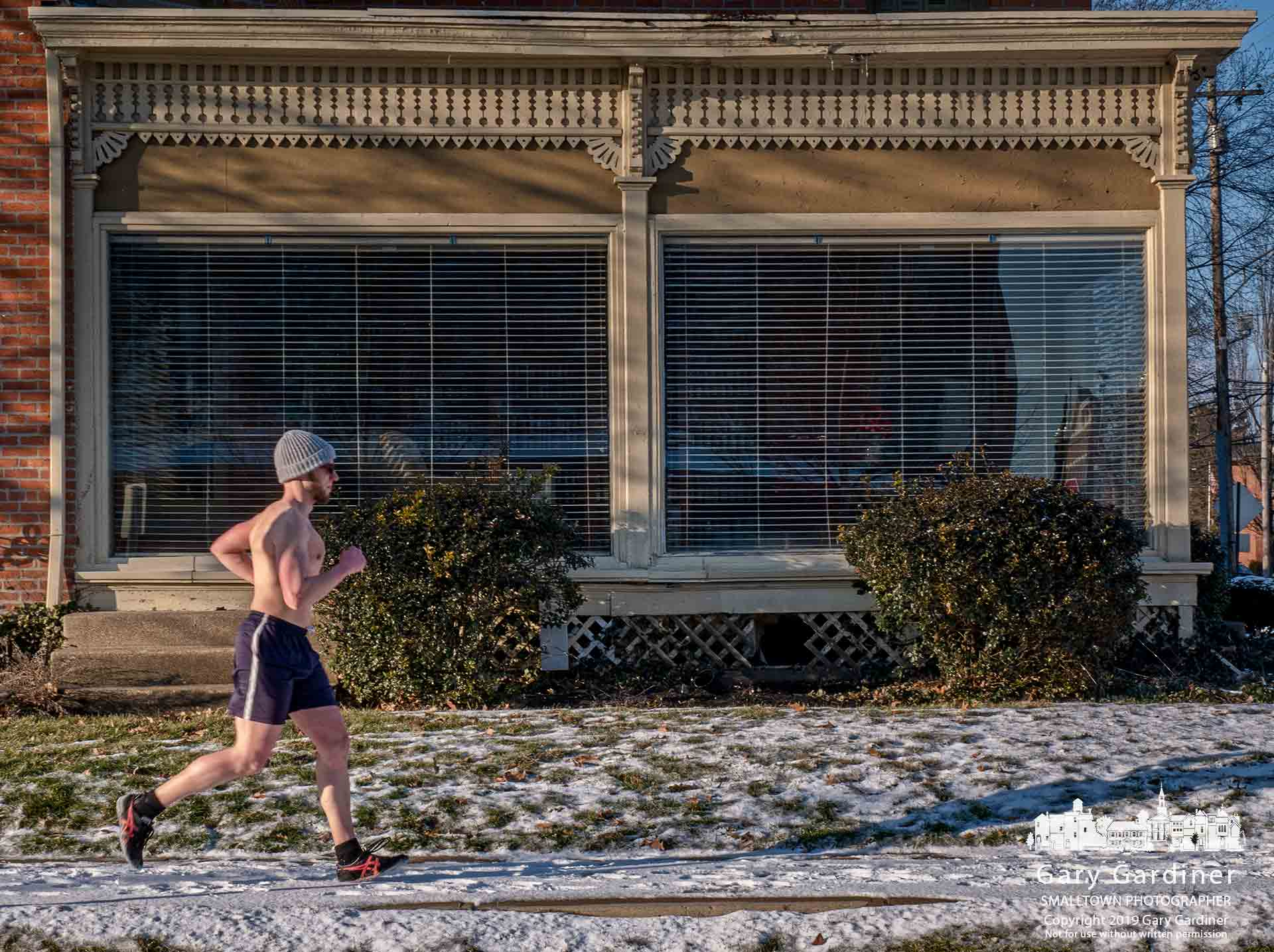 Theodore Gorman runs without a shirt with the temperature in the low 20s as he nears completion of his afternoon exercise. My Final Photo for Jan. 27, 2019.