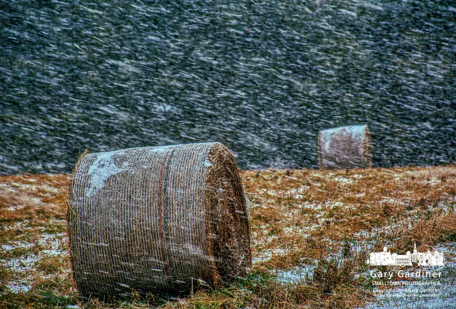 A morning snow squall blows heavy snow across bales of hay on a farm field on North West Street in Westerville Thursday. My Final Photo for Jan. 10, 2019.