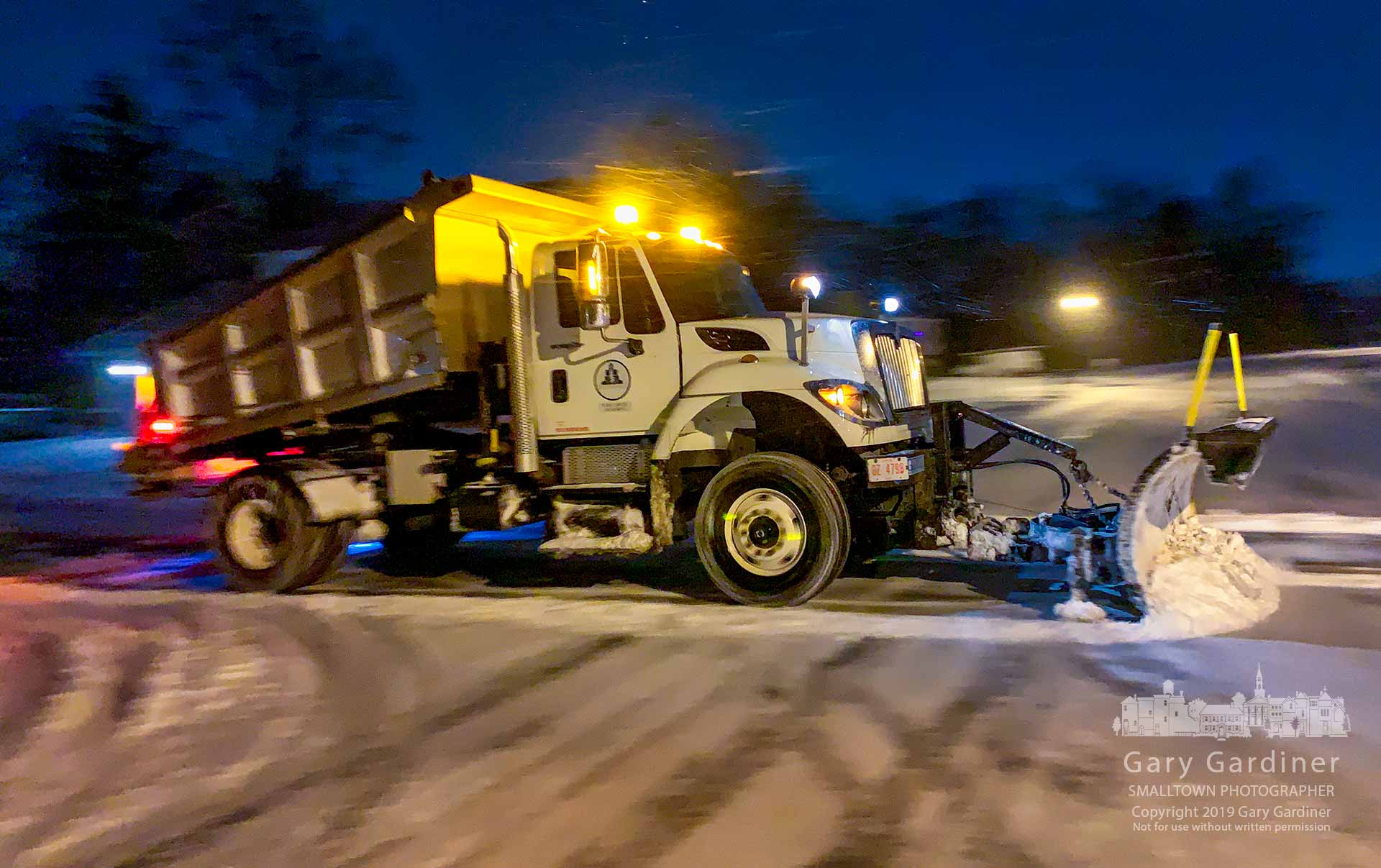 A Westerville snow plow and salt truck runs across Gentlewind Drive on its way to plow side streets after an overnight storm dropped more snow on the city. My Final Photo for Jan. 20, 2019.