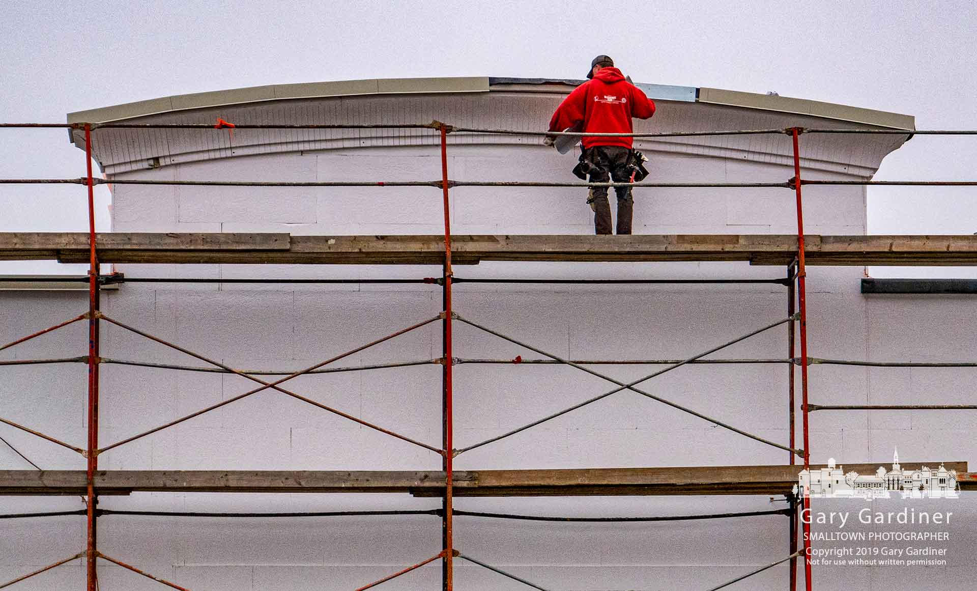 A worker installs a section of the new facade for Glengary Shopping Center as the owner upgrades and renovates the center after the opening of the new Aldi grocery store. My Final Photo for Feb. 7, 2019.