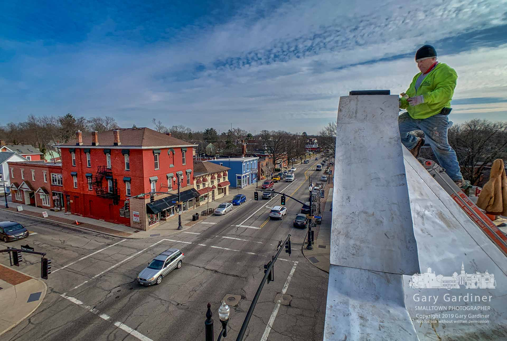 A roofer applies a rubber bladder to the top of the cornice on the roof of the Cockerell Building as renovations for the structure near completion. My Final Photo for Feb. 26, 2019.