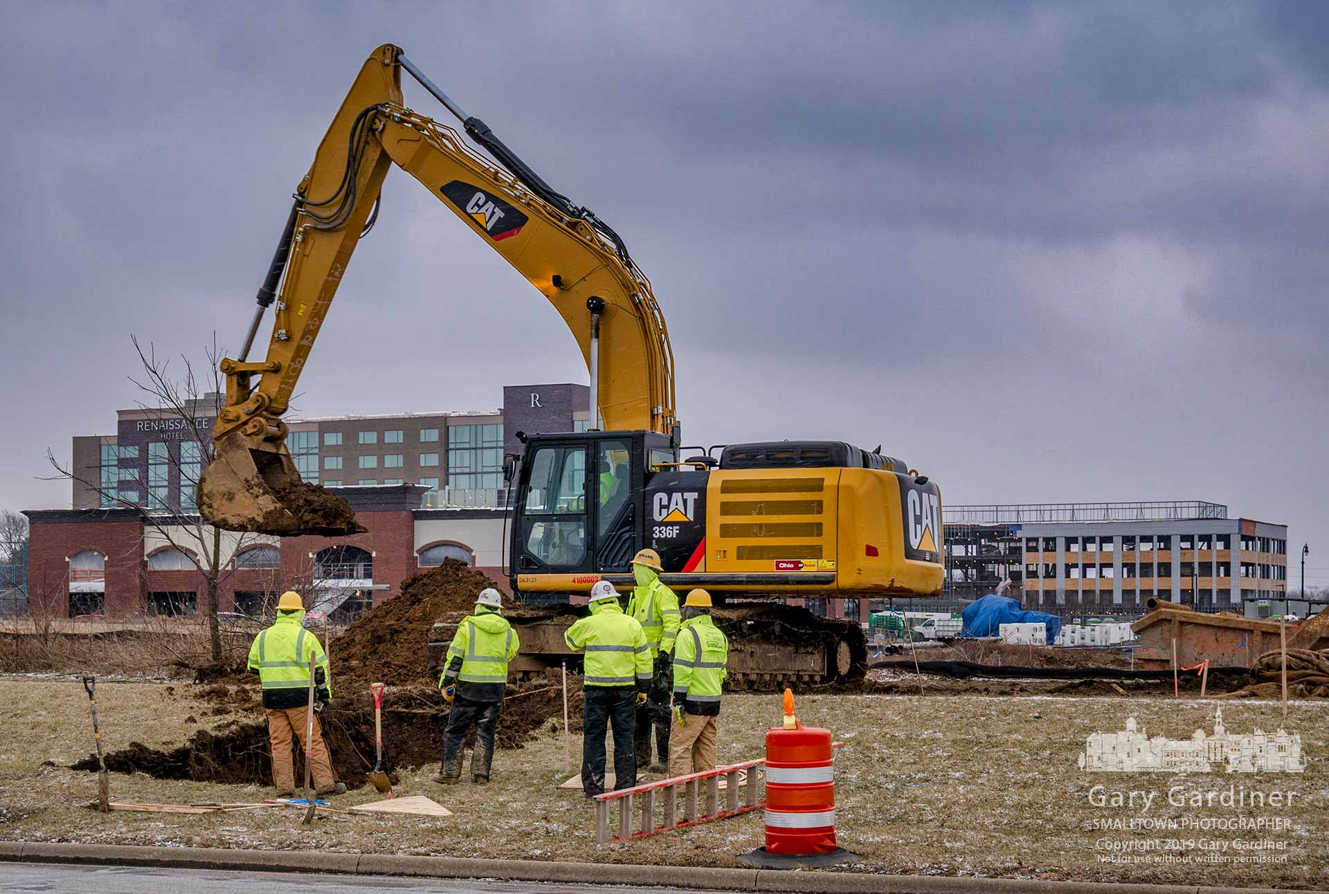 A work crew taps into a water line as construction begins for a new roadway leading into Westar from Polaris Parkway where several restaurants are approved for construction. My Final Photo for Feb. 13, 2019.