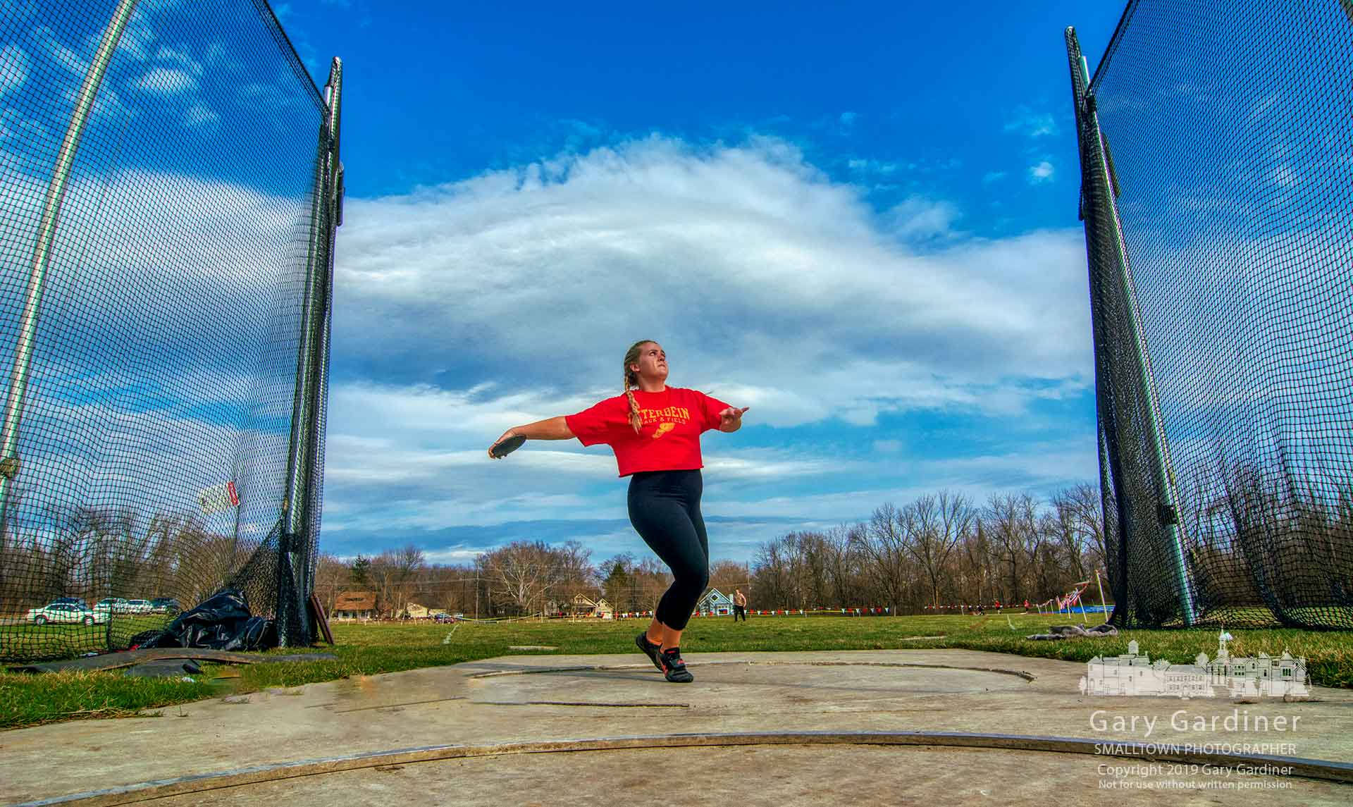 A discus athlete at Otterbein makes her last throws of the day in practice for the opening of the track and field season in two days. My Final Photo for March 28, 2019.
