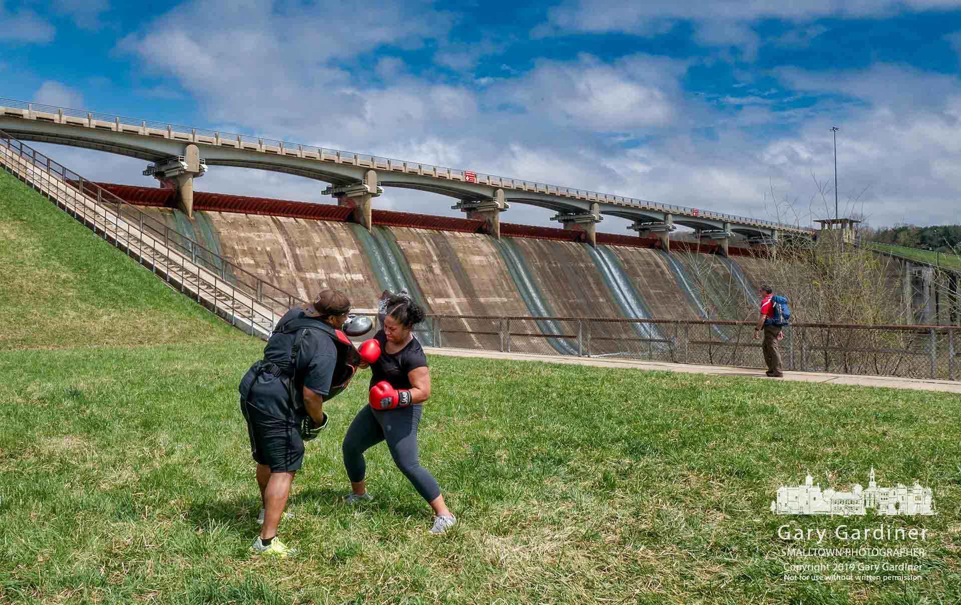 A pair of boxers train on the grassy landing at the base of Hoover Dam as another person trains for a summer hiking adventure in West Virginia on a sunny and crisp Sunday afternoon. My Final Photo for April 14, 2019.