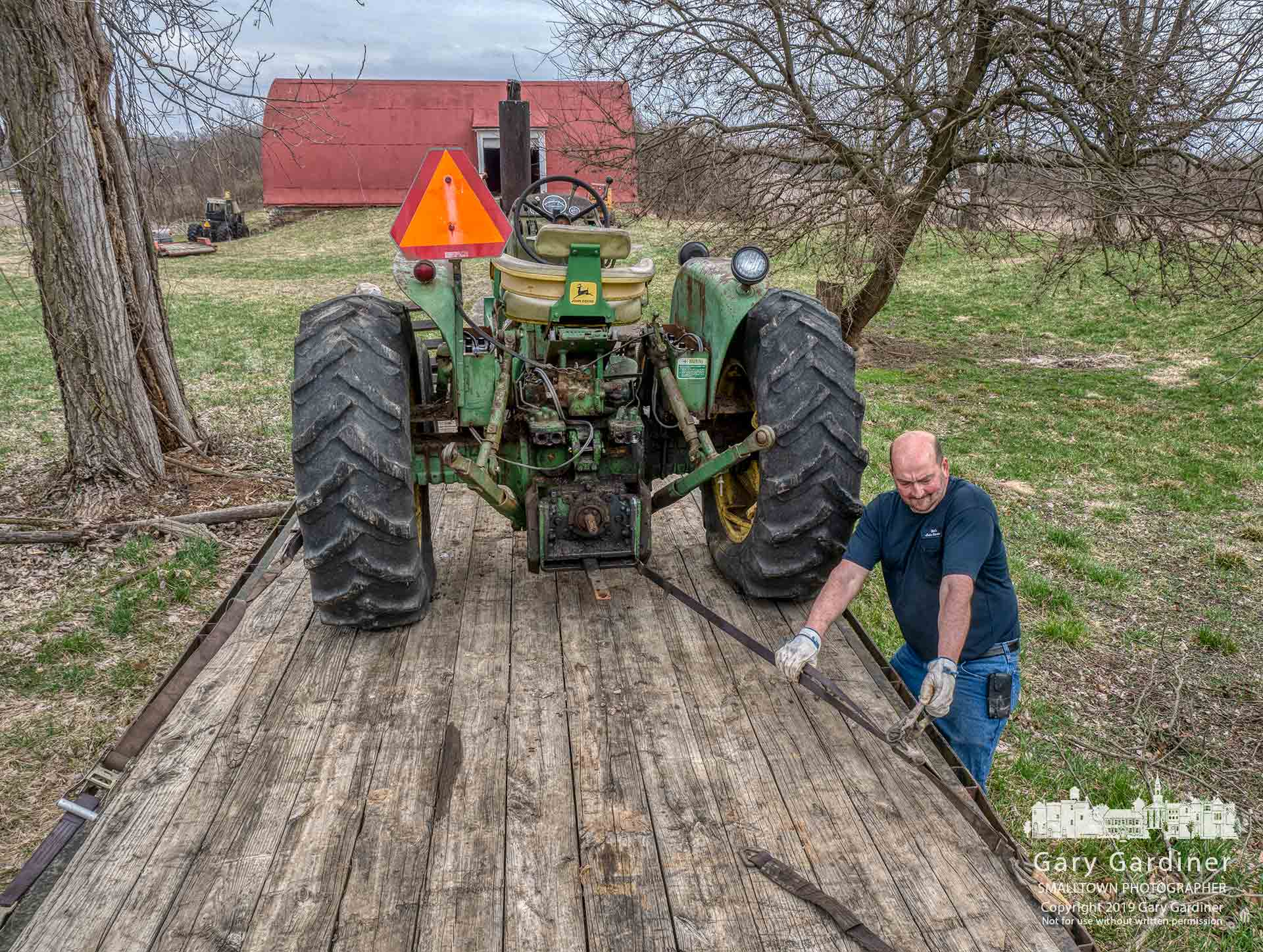A tractor being moved from the Braun Farm is cinched tight after being loaded on a trailer Sunday afternoon. My Final Photo for April 7, 2019.