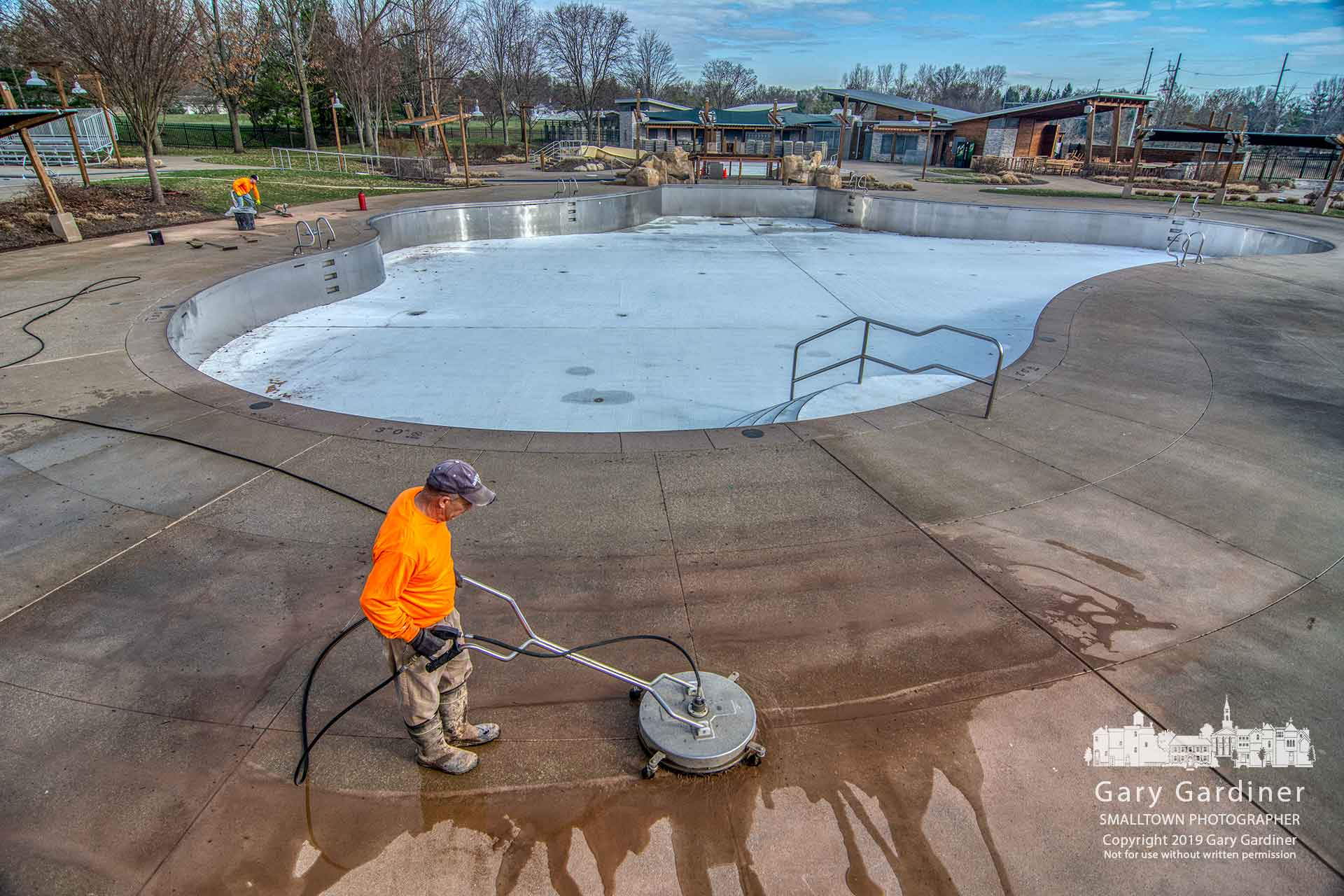 Preparations for an early opening of Highlands Park Aquatic Center continued Saturday as workers scrubbed and power washed the concrete walkways in the center. My Final Photo for April 6, 2019.