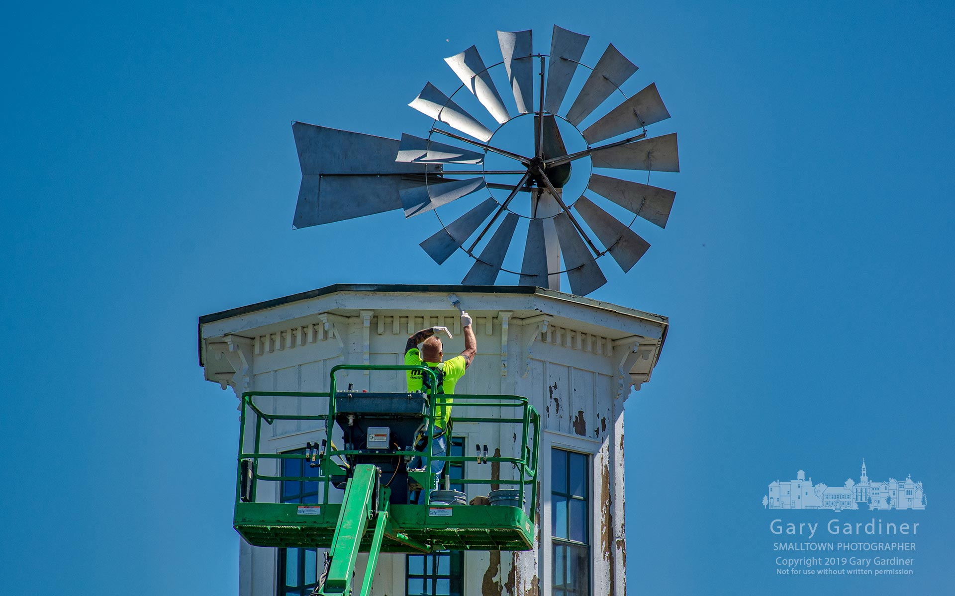 A painter applies a coat of primer to the top of the tower on the Everal Barn at Heritage Park in Westerville as the park undergoes minor upgrades and repairs. My Final Photo for April 22, 2019.