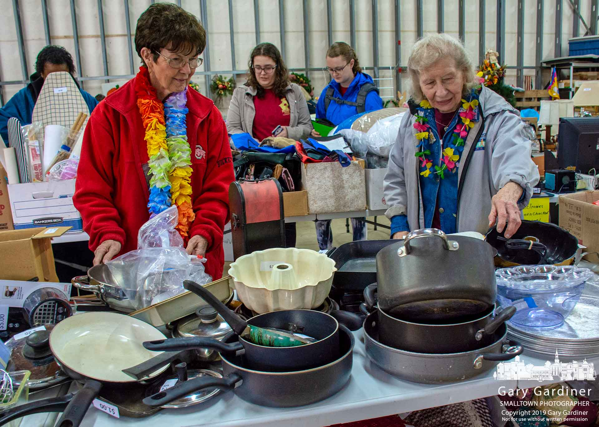 Shoppers inspect the collection of donated items for sale at the annual Senior Center Garage Sale Thursday afternoon. My Final Photo for April 25, 2019.