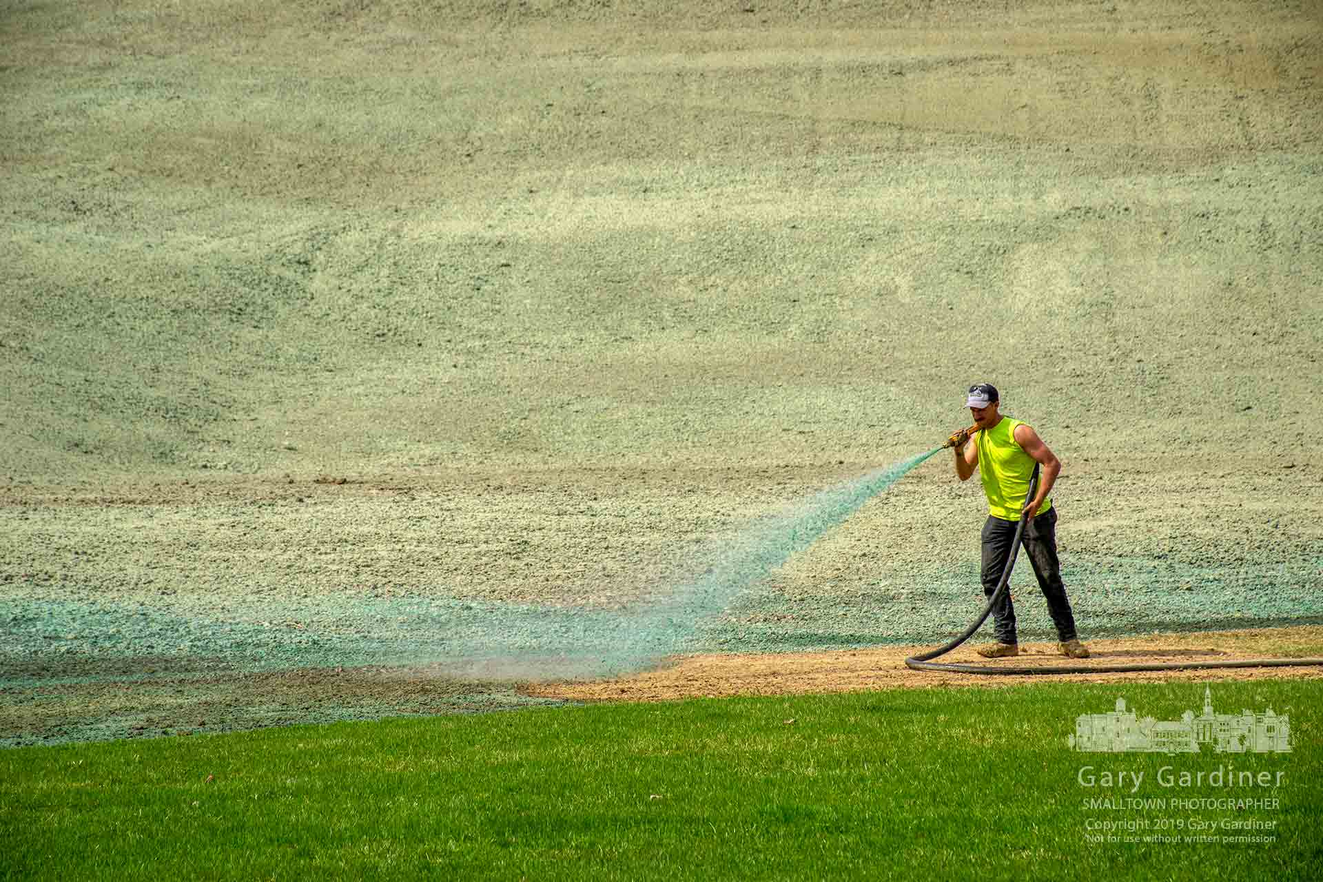 A landscaper sprays hydroseed at the base of the newly built and seeded sledding hill at Alum Creek Park South near the skate park, BMX trail, and outdoor hockey rink. My Final Photo for April 11, 2019.