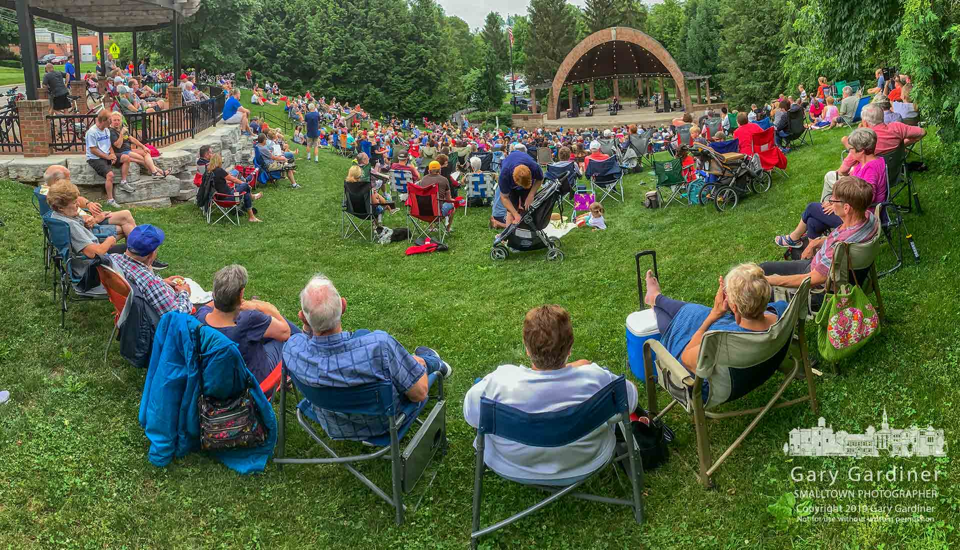 Family and friends gather in a large arc at the top edge of the Alum Creek Amphitheater to listen to The Reaganomics in the opening concert of the Summer Concert Series at the park. My Final Photo for June 9, 2019.