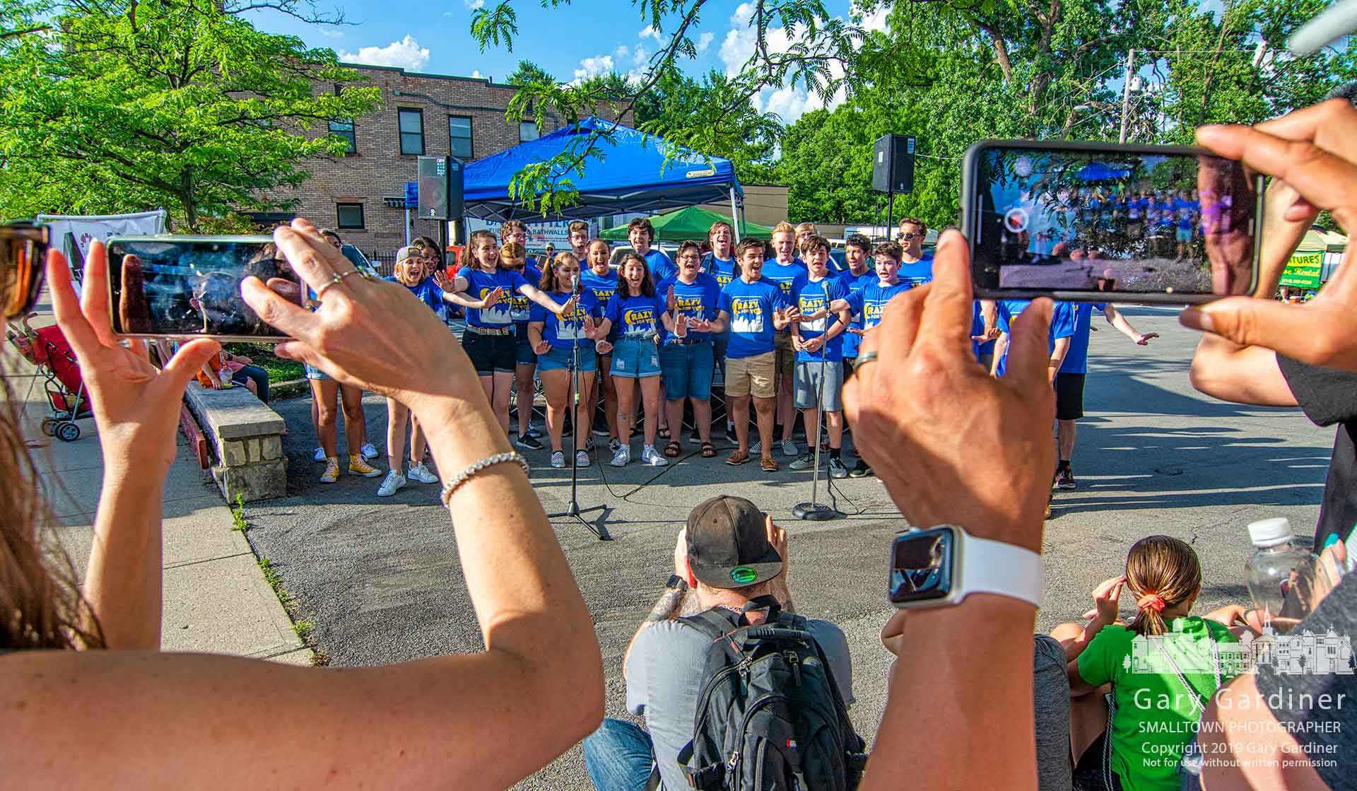 "Fans take photos during Fourth Friday in Uptown of the combined Westerville high school theater students performing songs from ""Crazy For You"" which they will present in July at Westerville North. My Final Photo for June 28, 2019."