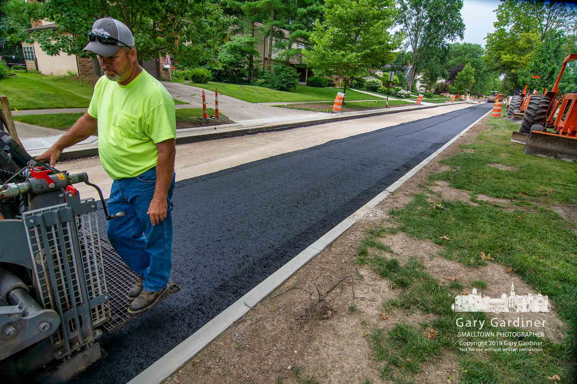 A crew lays the first layer of asphalt on a northbound section of Spring Road after replacing the curbing and gutters and removing the old road surface. My Final Photo for June 27, 2019.