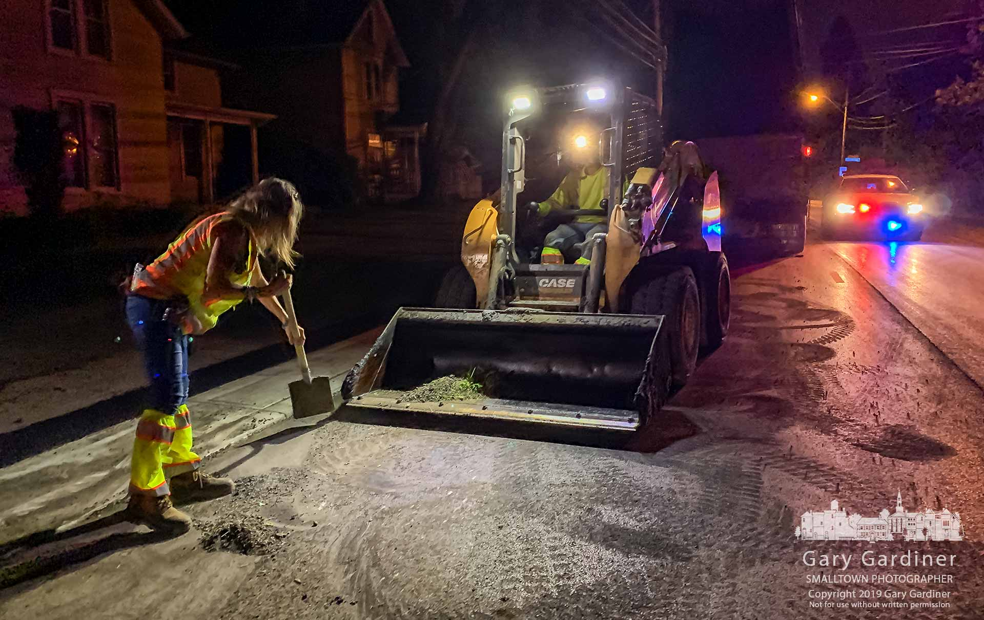 The overnight asphalt paving crew clears North State Street of the last pile of detritus left after completing the milling and repaving of the road from Hoff Rd. to Broadway. My Final Photo for June 8, 2019.
