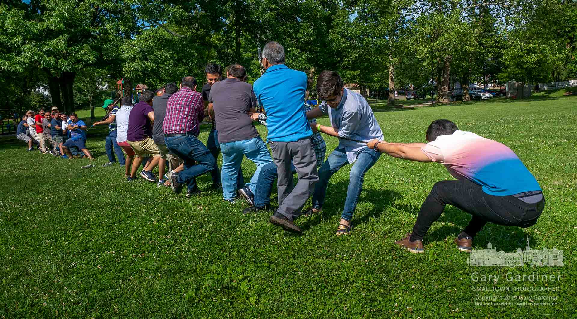 Two teams of men compete in a tug-of-war competition near the pavilion at Alum Creek Park North where they held a picnic for their temple. My Final Photo for June 22, 2019.